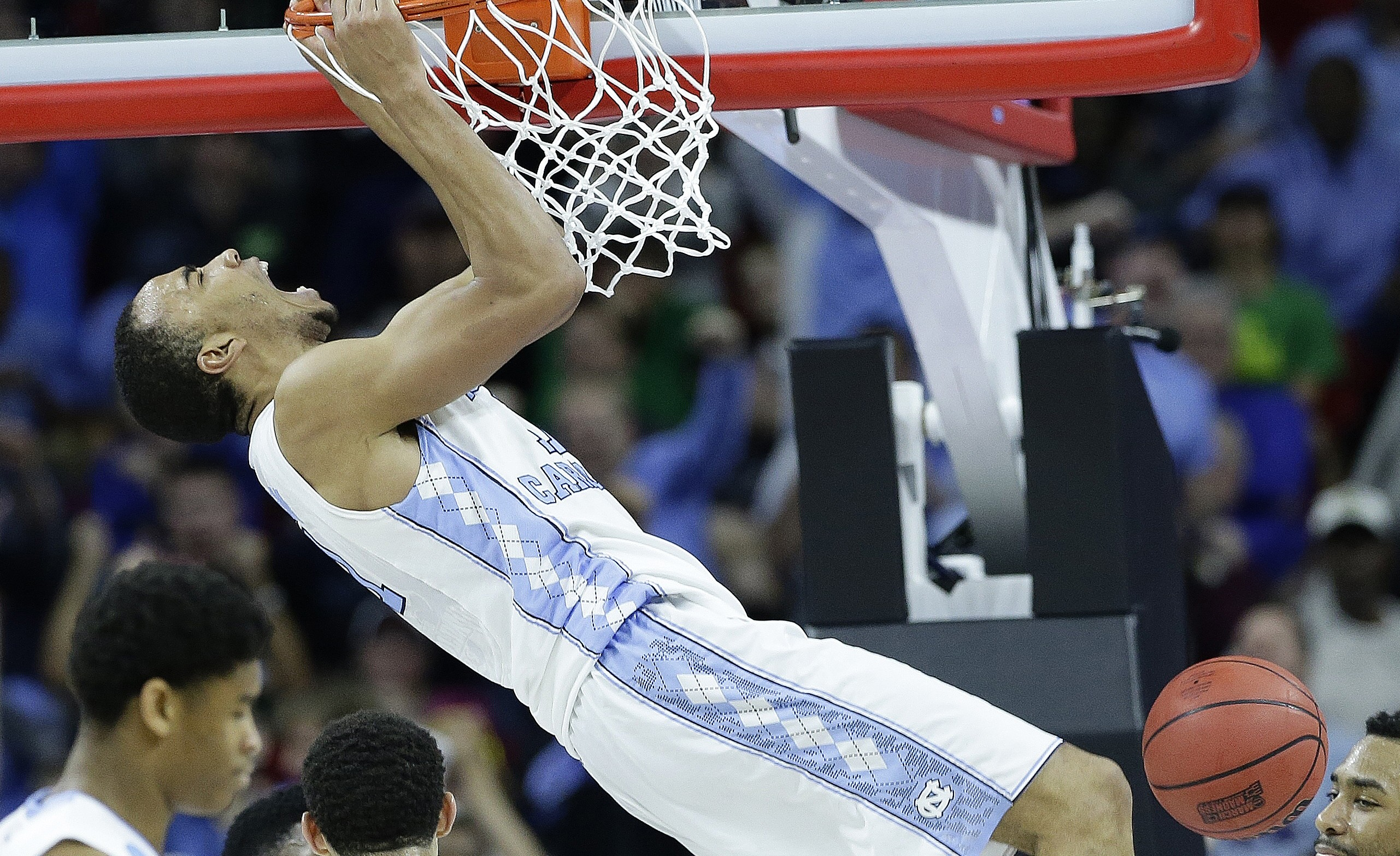 North Carolina forward Brice Johnson (11) reacts after dunking the ball against Providence guard Jalen Lindsey (21) during the second half of a second-round men's college basketball game in the NCAA Tournament, Saturday, March 19, 2016, in Raleigh, N.C. (AP Photo/Gerry Broome)