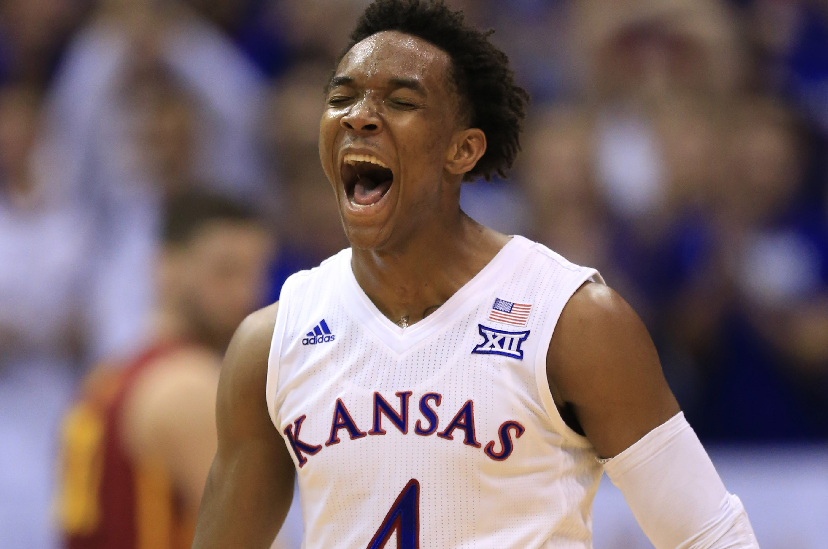 Kansas guard Devonte' Graham (4) celebrates a 3-point basket during the second half of an NCAA college basketball game against Iowa State in Lawrence, Kan., Saturday, March 5, 2016. Kansas defeated Iowa State 85-78. (AP Photo/Orlin Wagner)