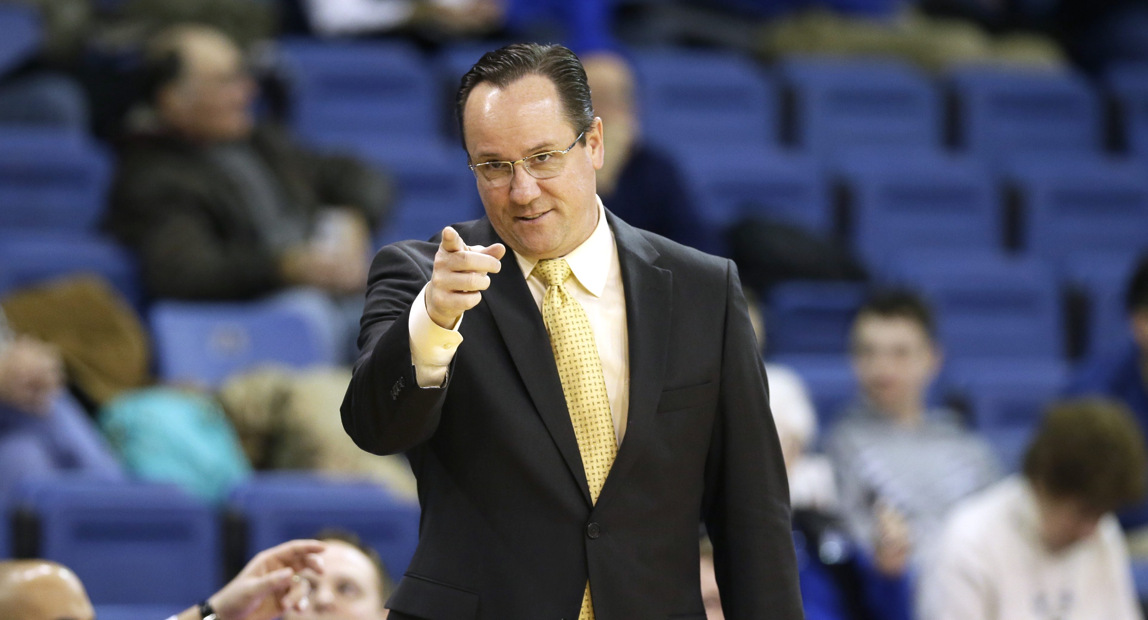 FILE - In this Feb. 9, 2016, file photo, Wichita State head coach Gregg Marshall directs his team during the second half of an NCAA college basketball game against Drake, in Des Moines, Iowa. At this time of year college basketball coaches often sound like political candidates looking for votes as they tout their teams' NCAA tournament worthiness. (AP Photo/Charlie Neibergall, File)