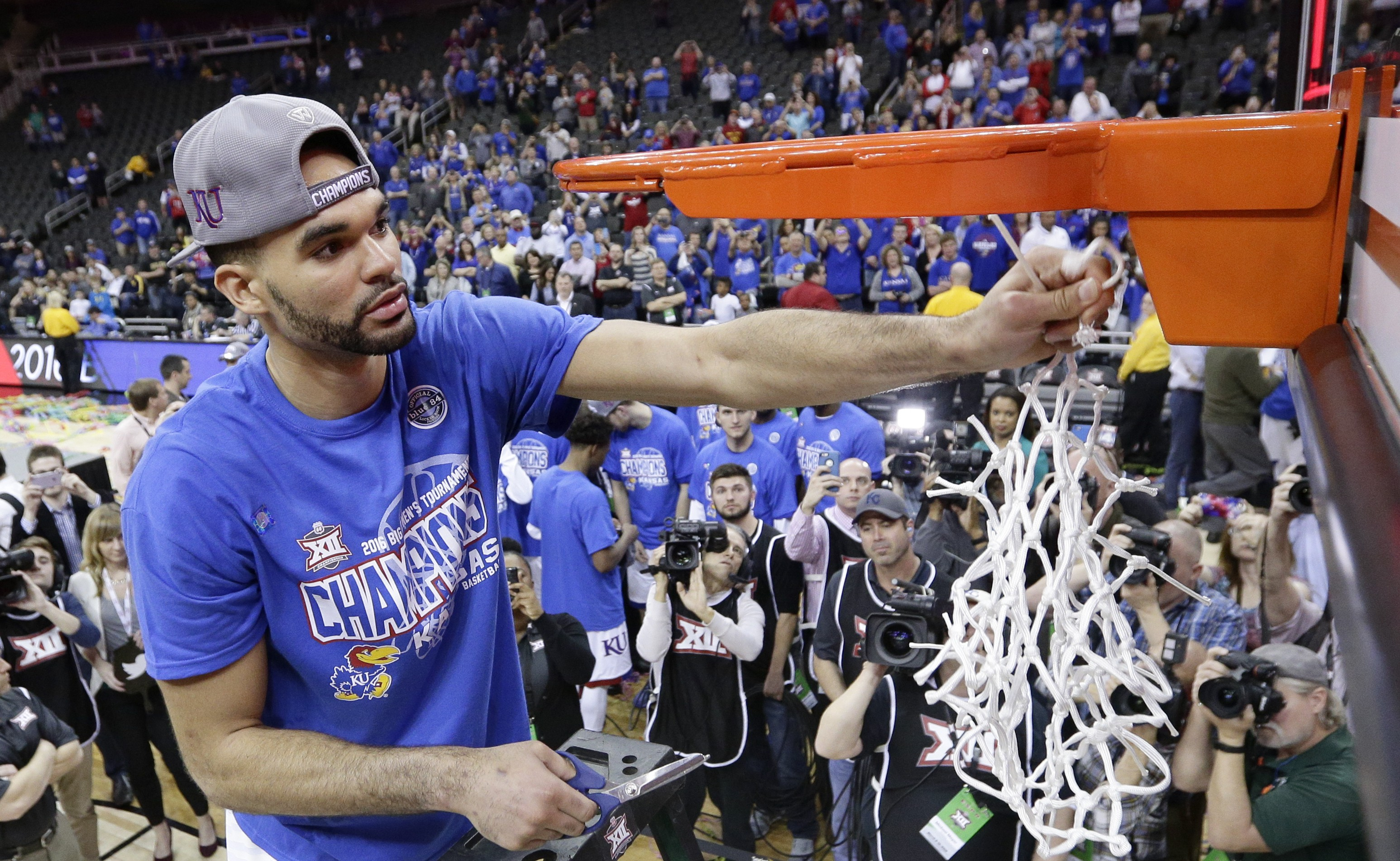 Kansas' Perry Ellis cuts a piece of the net (AP Photo/Charlie Riedel)