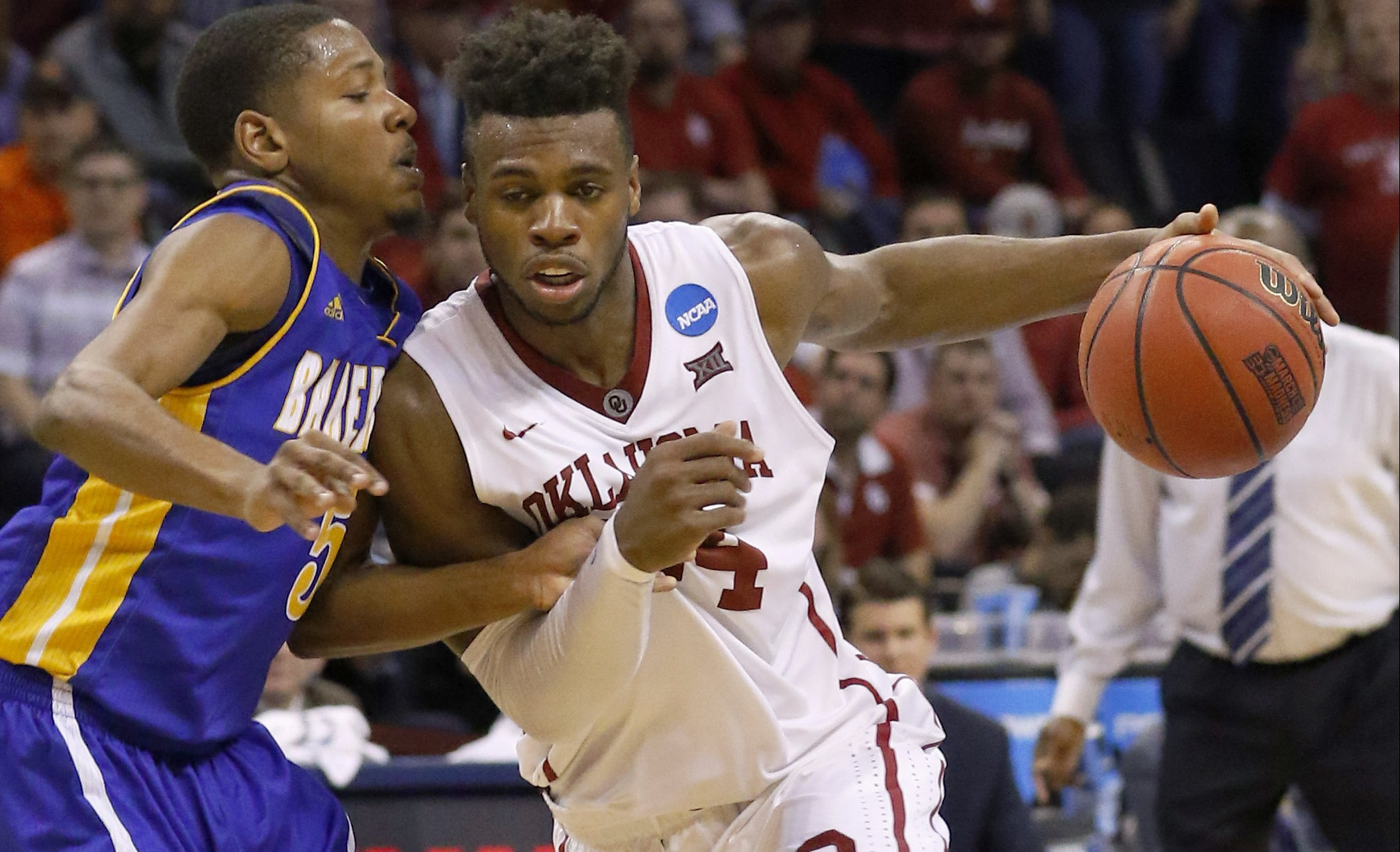 Oklahoma guard Buddy Hield (24) drives to the basket around Cal State Bakersfield guard Dedrick Basile (5) in the second half during a first-round men's college basketball game in the NCAA Tournament in Oklahoma City, Friday, March 18, 2016. Oklahoma won 82-68. (AP Photo/Alonzo Adams)