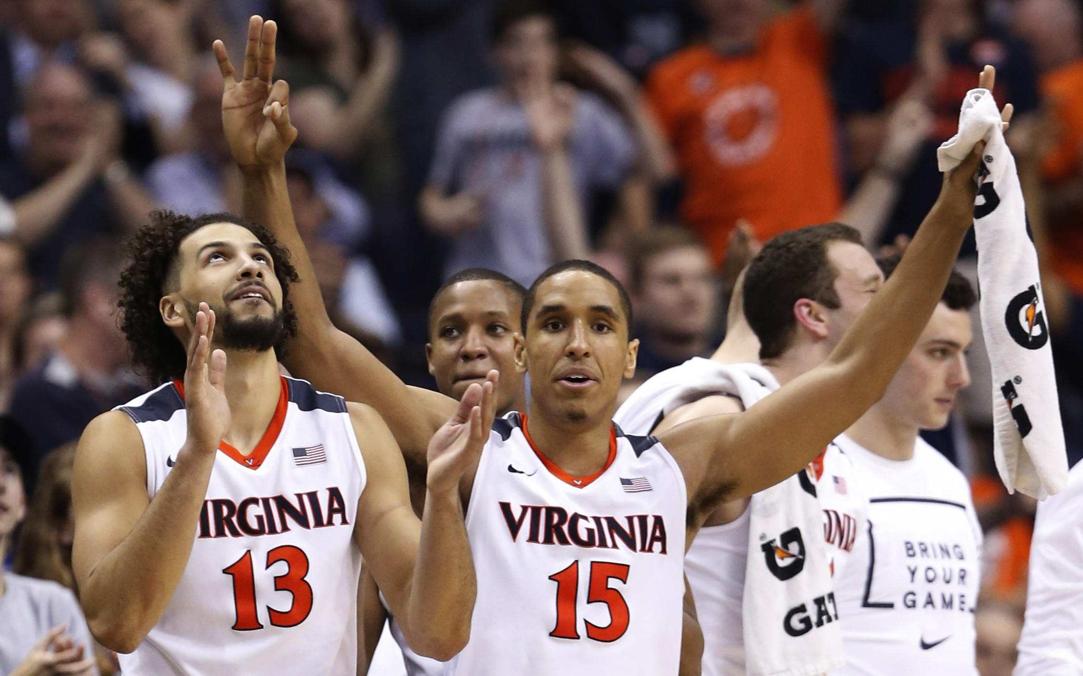 Virginia guard Malcolm Brogdon (15) and forward Anthony Gill (13) cheer their team during the second half against Georgia Tech in an NCAA college basketball game in the Atlantic Coast Conference men's tournament, in Washington on Thursday, March 10, 2016. Virginia defeated Georgia Tech 72-52. (AP Photo/Steve Helber)