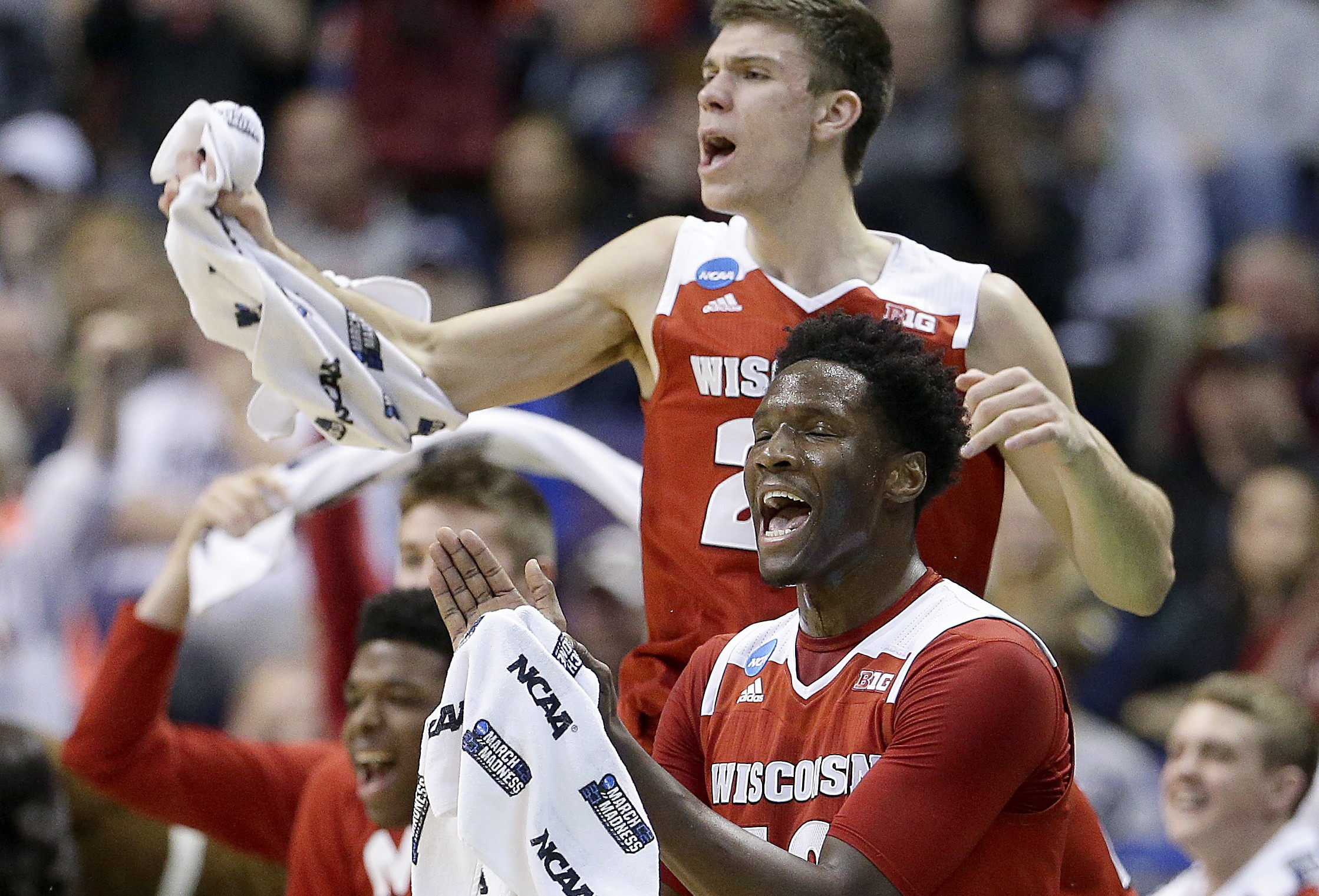 The Wisconsin bench celebrates a basket during the first half of a second-round men's college basketball game against Xavier in the NCAA Tournament, Sunday, March 20, 2016, in St. Louis. (AP Photo/Charlie Riedel)