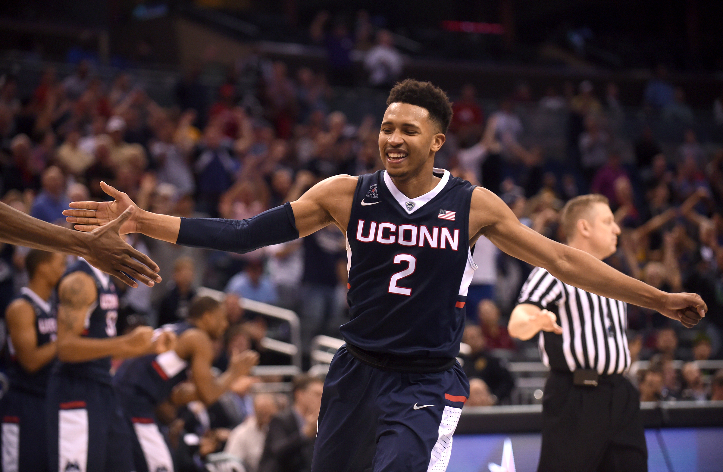 Connecticut guard Jalen Adams (2) celebrates a 3-pointer from half court at the end of the triple overtime to tie the NCAA college basketball game against Cincinnati in the quarterfinals of the American Athletic Conference men's tournament Friday, MArch 11, 2016, in Orlando, Fla. UConn won104-97 in quadruple overtime. (Brad Horrigan/Hartford Courant via AP) MANDATORY CREDIT
