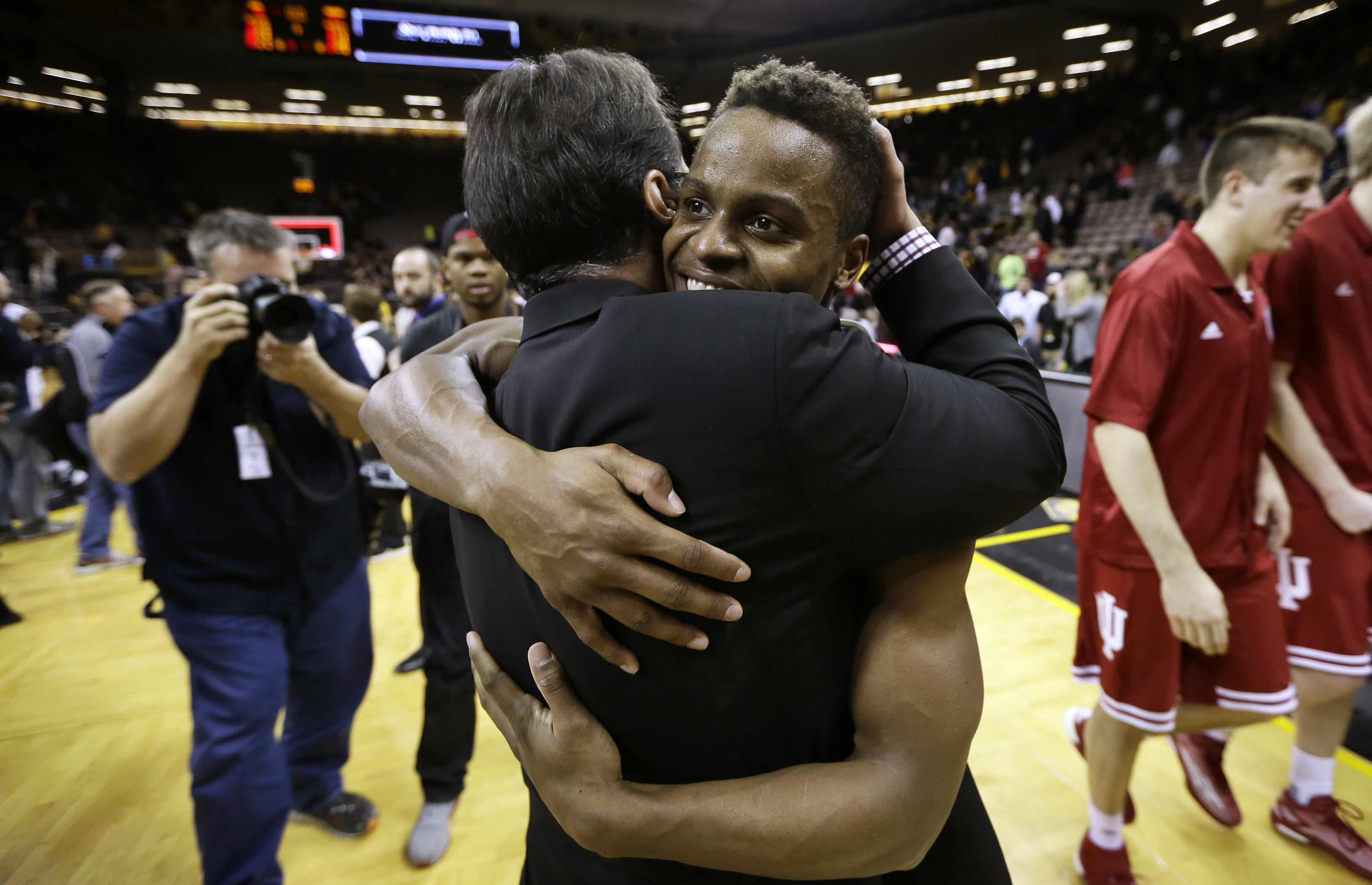 Indiana guard Yogi Ferrell gets a hug from coach Tom Crean, left, after the team's NCAA college basketball game against Iowa, Tuesday, March 1, 2016, in Iowa City, Iowa. Ferrell scored 20 points as Indiana won 81-78 and clinched the Big Ten title. (AP Photo/Charlie Neibergall)