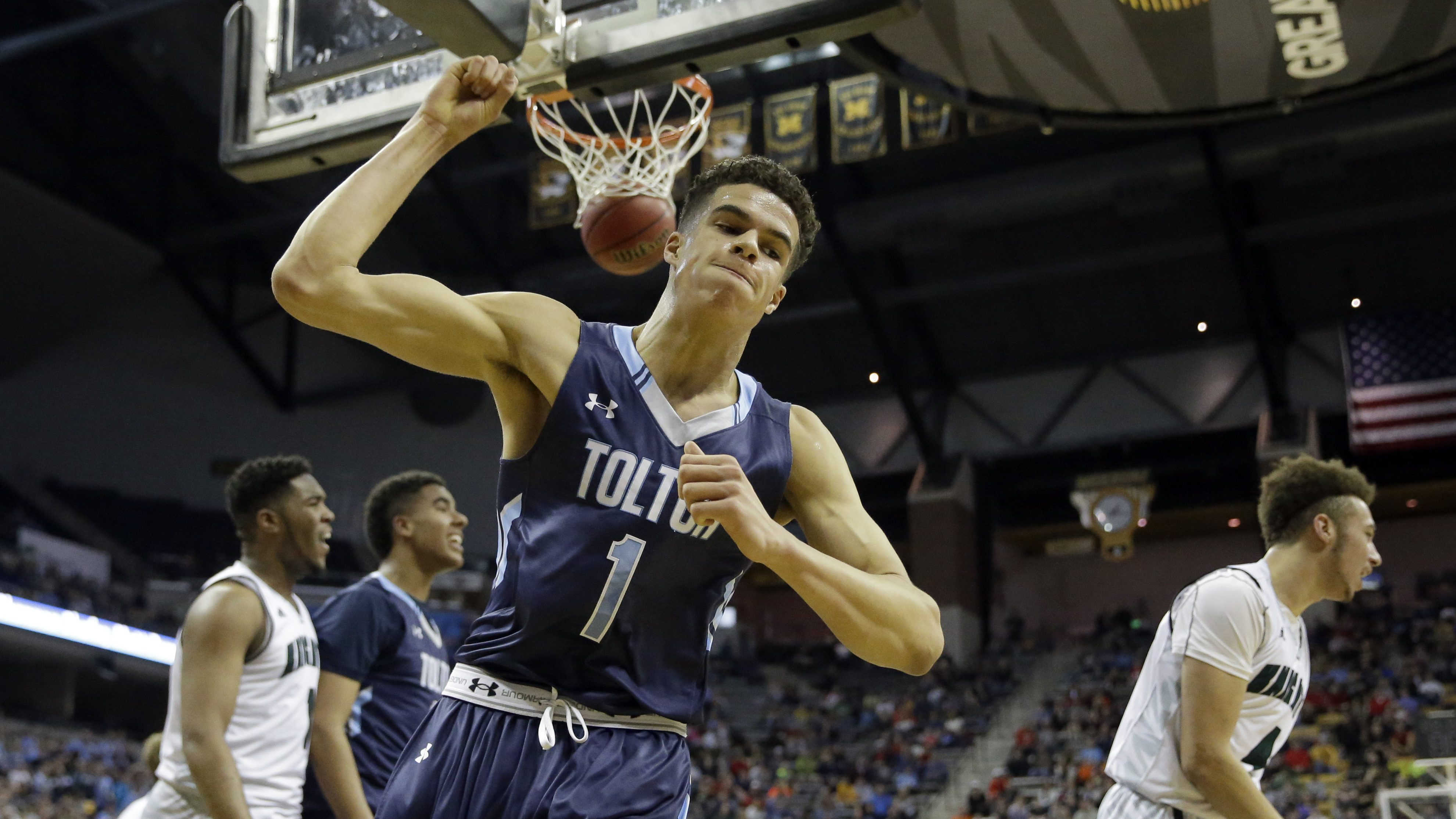Father Tolton Catholic's Michael Porter, Jr. (1) celebrates after sinking a basket and drawing a foul during the first half of the Missouri Class 3 boys high school championship basketball game against the Barstow Saturday, March 12, 2016, in Columbia, Mo. (AP Photo/Jeff Roberson)