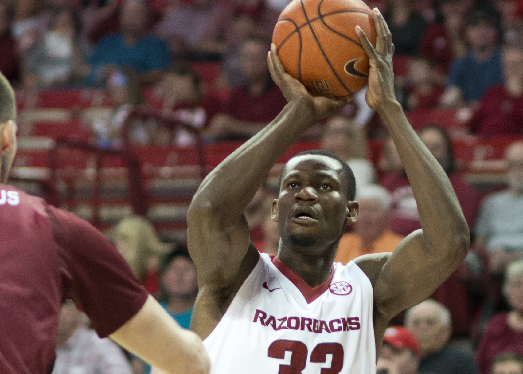 Arkansas' Moses Kingsley (33) shoots a basket over South Carolina's Laimonas Chatkevicius (14) in the first half of an NCAA college basketball game against South Carolina in Fayetteville, Ark., Saturday, March 5, 2016. (AP Photo/Sarah Bentham)