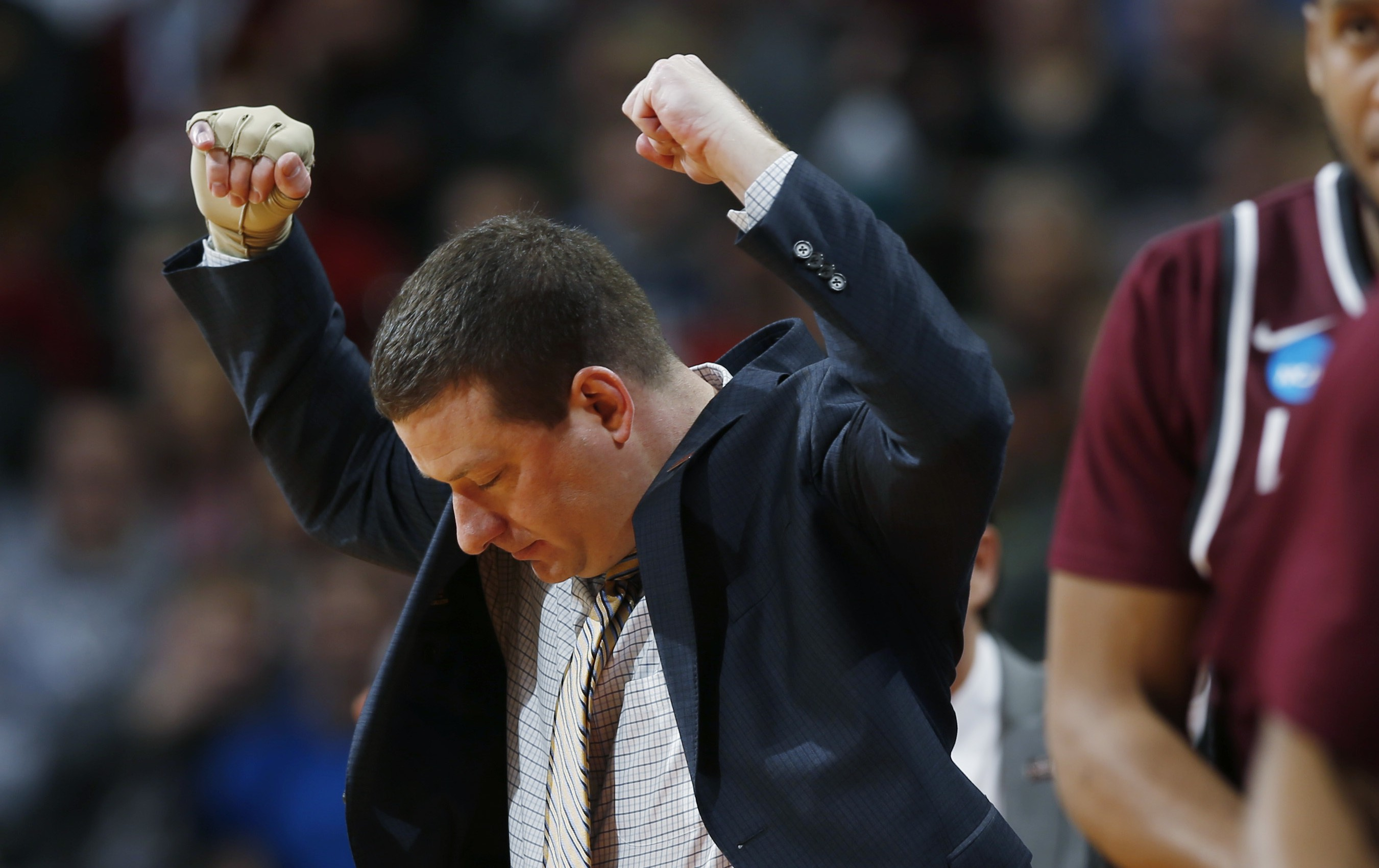 Arkansas Little Rock head coach Chris Beard reacts after his team draws a foul against Iowa State during the first half of a second-round men's college basketball game Saturday, March 19, 2016, in the NCAA Tournament in Denver. (AP Photo/David Zalubowski)