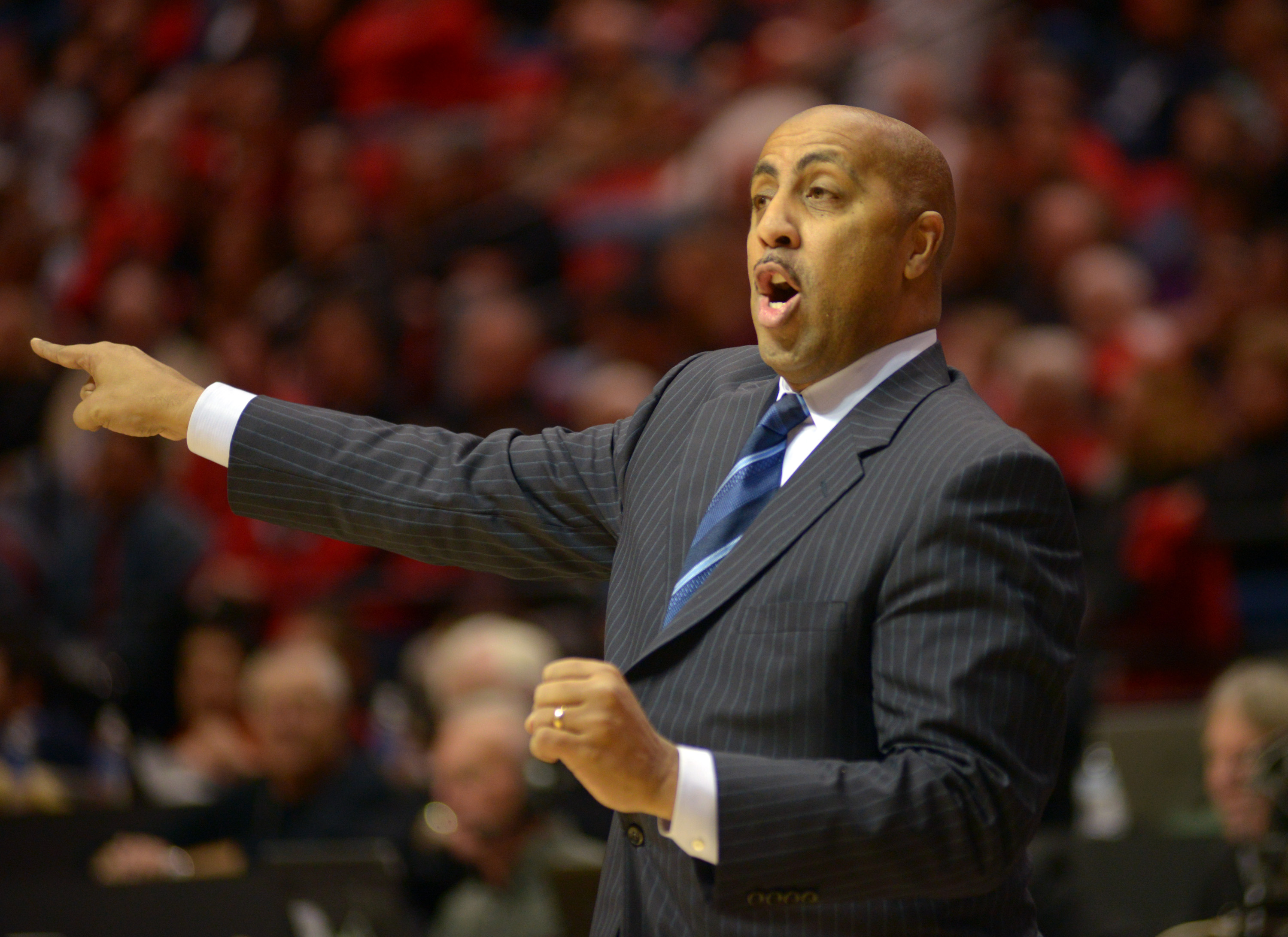 SAN DIEGO, CA - DECEMBER 8: Coach Lorenzo Romar of the Washington Huskies directs his players in the first half of the game against the San Diego State Aztecs at the Viejas Arena on December 8, 2013 in San Diego, California. (Photo by Kent C. Horner/Getty Images)