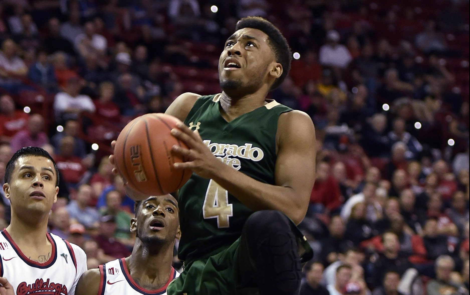 Colorado State's John Gillon (4) shoots against Fresno State during the first half of an NCAA college basketball game in the semifinals at the Mountain West Conference men's tournament Friday, March 11, 2016, in Las Vegas. (AP Photo/David Becker)
