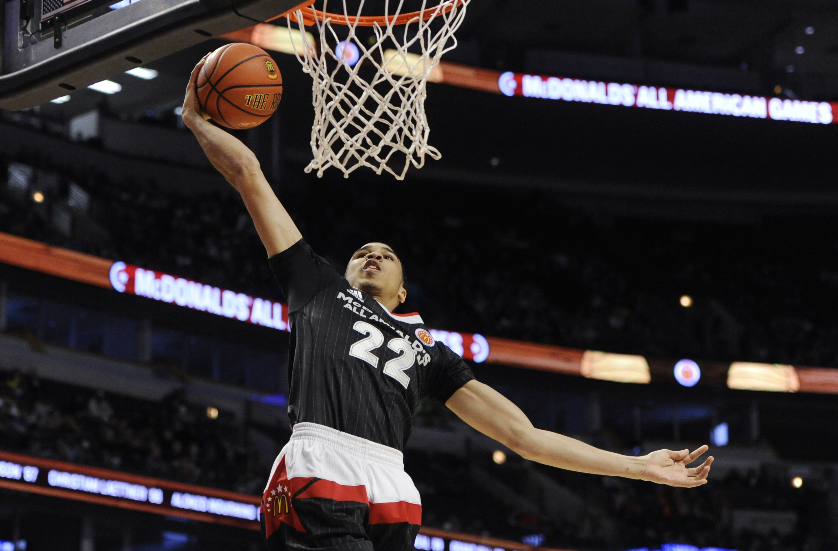 East forward Jayson Tatum, from Chaminade in St. Louis dunks against the West team during the McDonald's All-American boys basketball game, Wednesday, March 30, 2016, in Chicago. The West won 114-107. (AP Photo/Matt Marton)