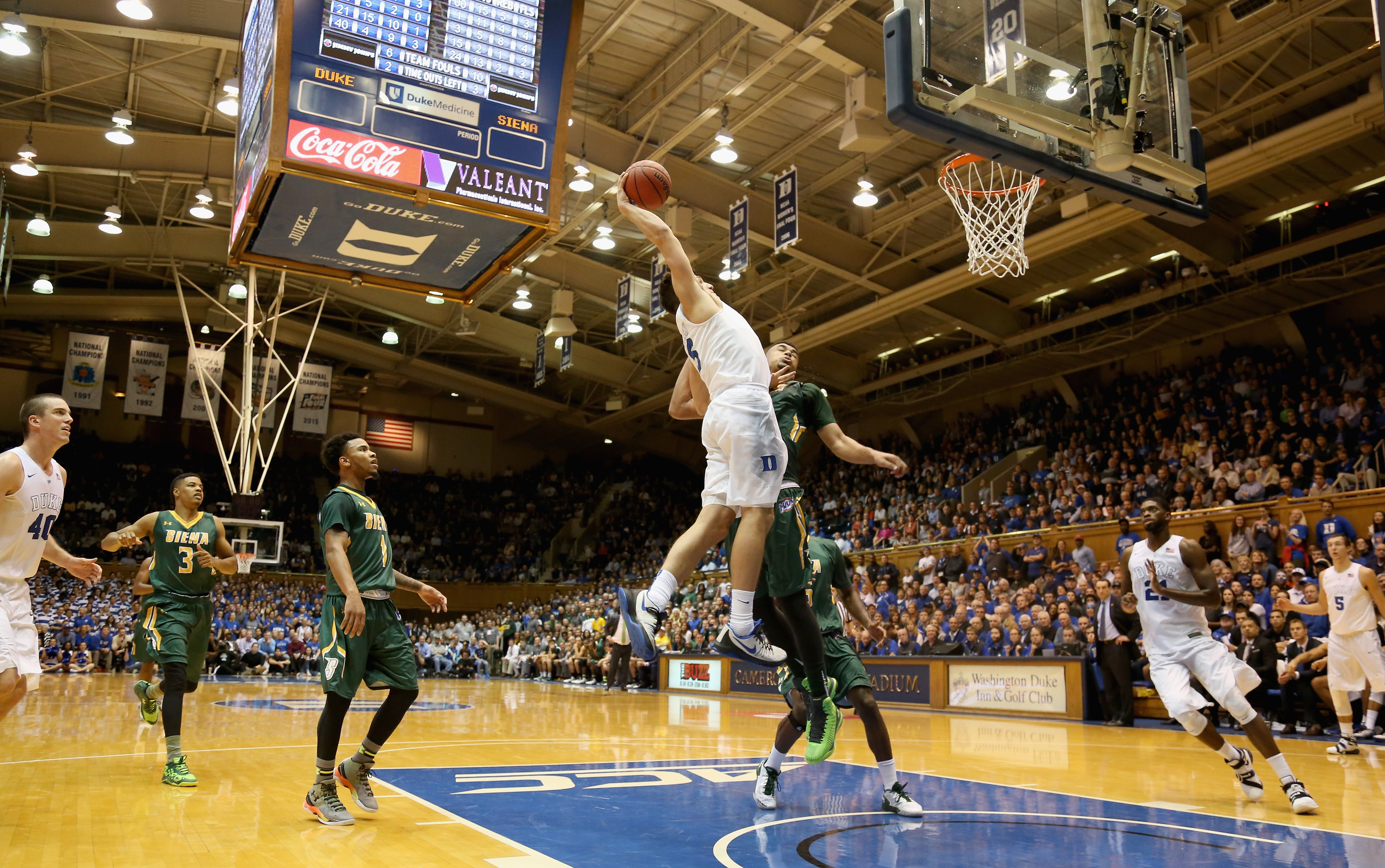 DURHAM, NC - NOVEMBER 13: Grayson Allen #3 of the Duke Blue Devils dunks over Javion Ogunyemi #0 of the Siena Saints during their game at Cameron Indoor Stadium on November 13, 2015 in Durham, North Carolina. (Photo by Streeter Lecka/Getty Images)