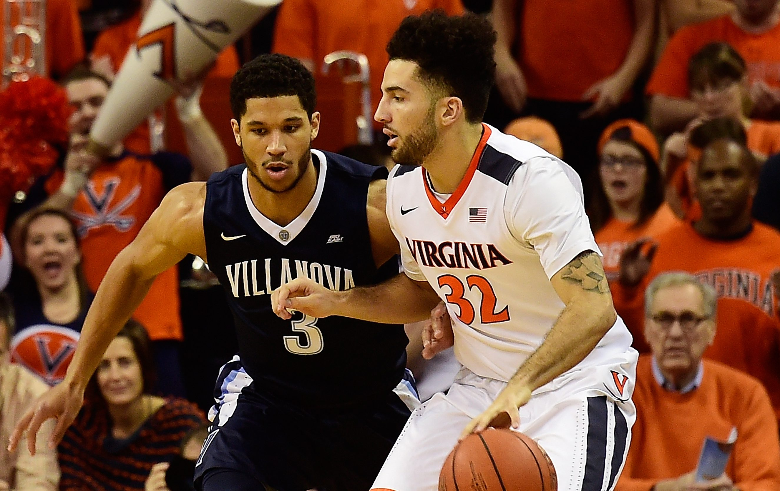 CHARLOTTESVILLE, VA - DECEMBER 19: London Perrantes #32 of the Virginia Cavaliers dribbles the ball against Josh Hart #3 of the Villanova Wildcats in the first half during a game at John Paul Jones Arena on December 19, 2015 in Charlottesville, Virginia. (Photo by Patrick McDermott/Getty Images)
