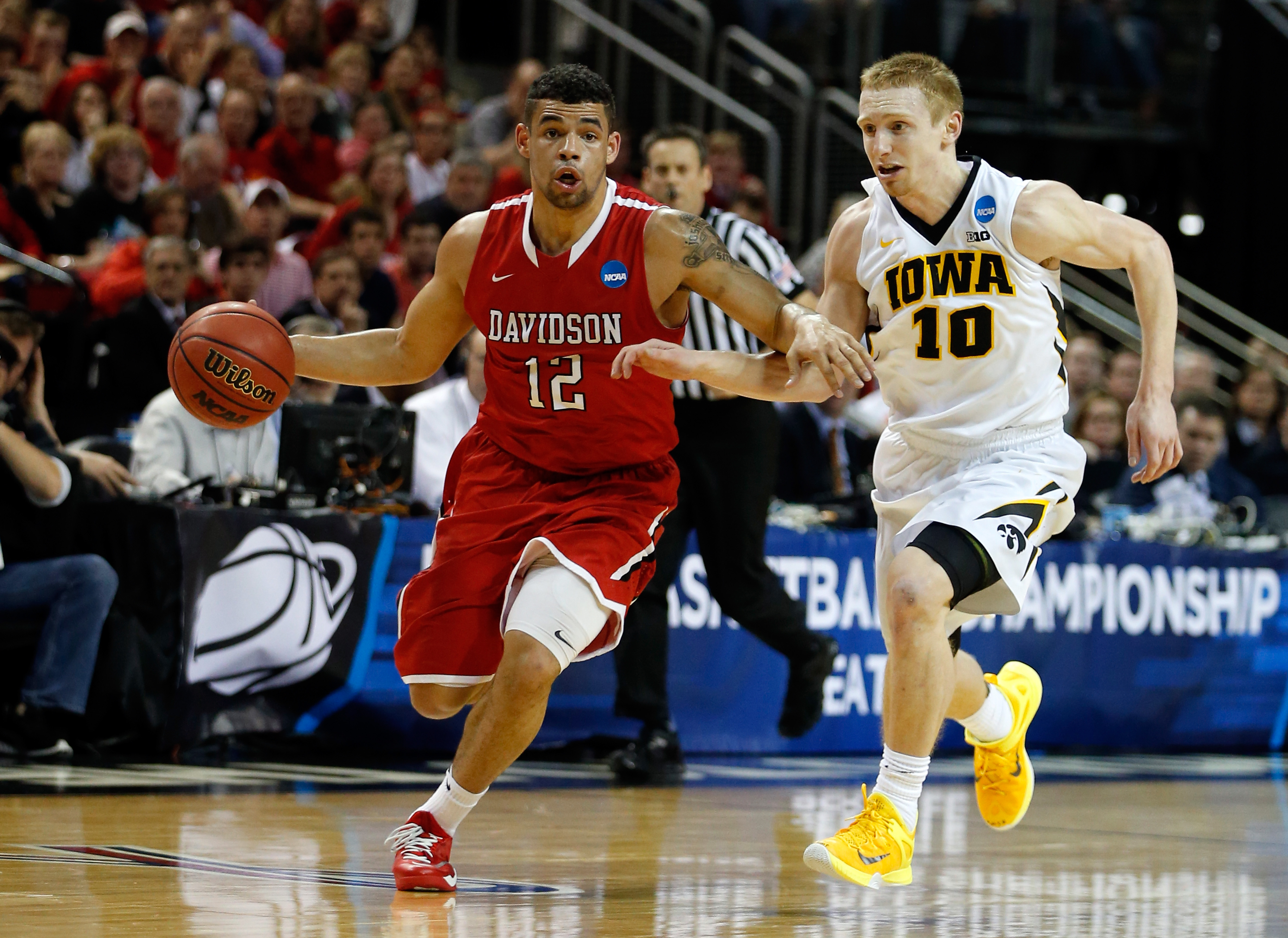 SEATTLE, WA - MARCH 20: Jack Gibbs #12 of the Davidson Wildcats dribbles the ball against Mike Gesell #10 of the Iowa Hawkeyes during the second round of the 2015 NCAA Men's Basketball Tournament at KeyArena on March 20, 2015 in Seattle, Washington. (Photo by Ezra Shaw/Getty Images)