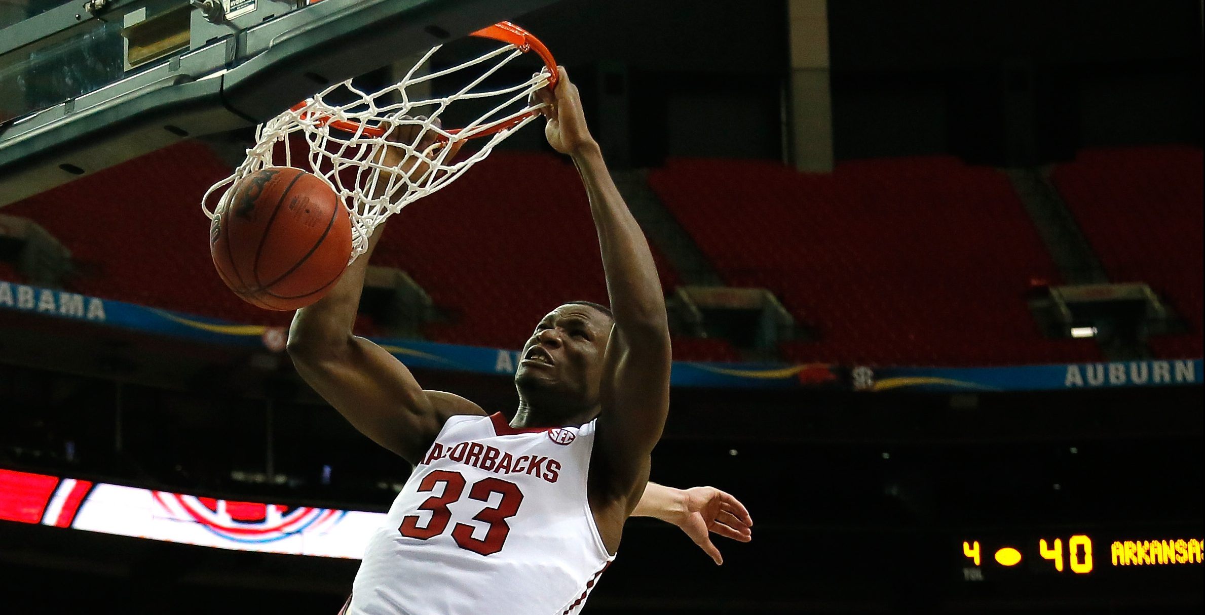 ATLANTA, GA - MARCH 13: Moses Kingsley #33 of the Arkansas Razorbacks dunks against the South Carolina Gamecocks during the second round of the SEC Men's Basketball Tournament at Georgia Dome on March 13, 2014 in Atlanta, Georgia. (Photo by Kevin C. Cox/Getty Images)