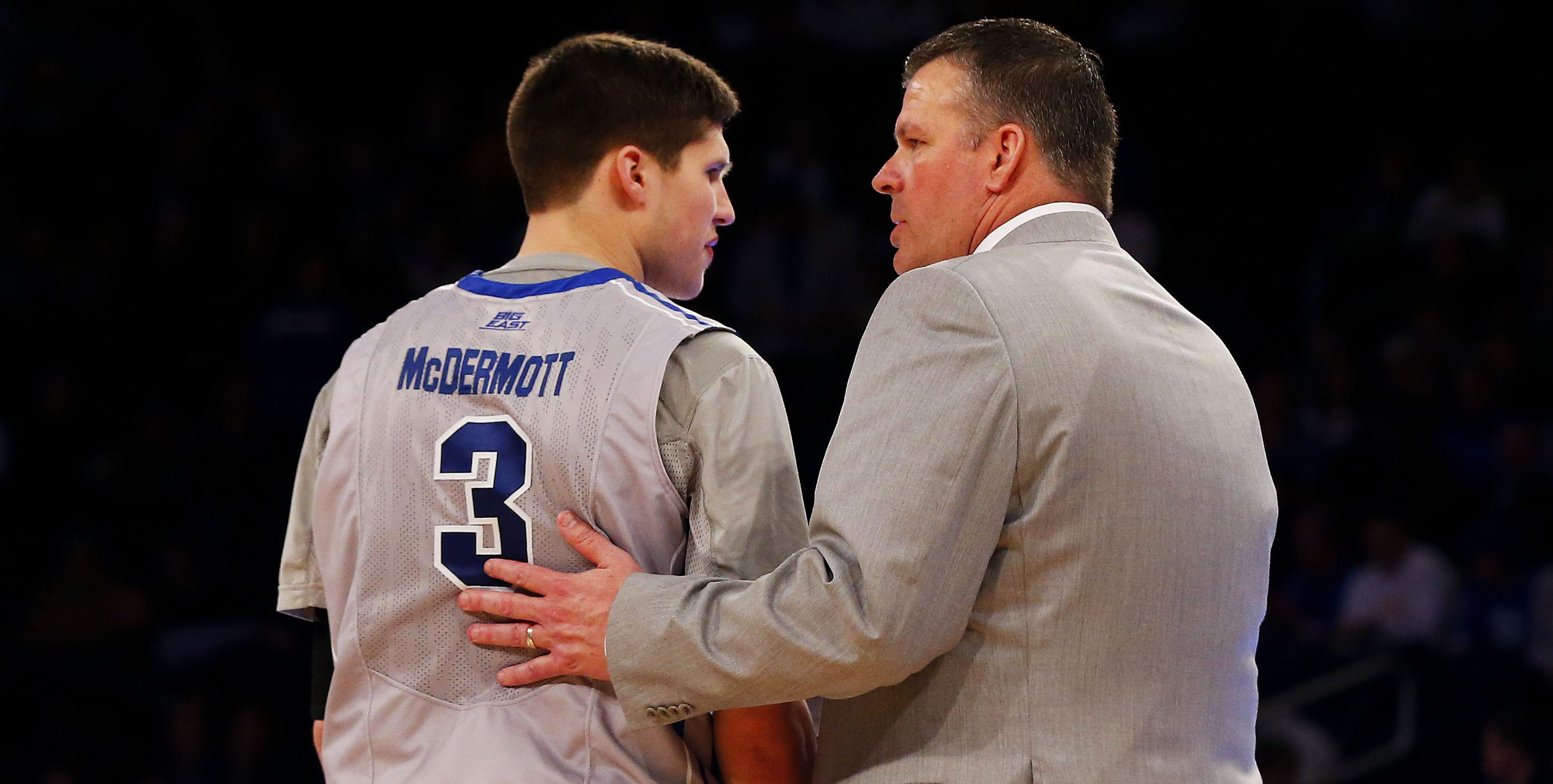 NEW YORK, NY - MARCH 14: Head coach Greg McDermott talks to his son Doug McDermott #3 of the Creighton Bluejays in the second half against the Xavier Musketeers during the Semifinals of the 2014 Men's Big East Basketball Tournament at Madison Square Garden on March 14, 2014 in New York City. (Photo by Jim McIsaac/Getty Images)