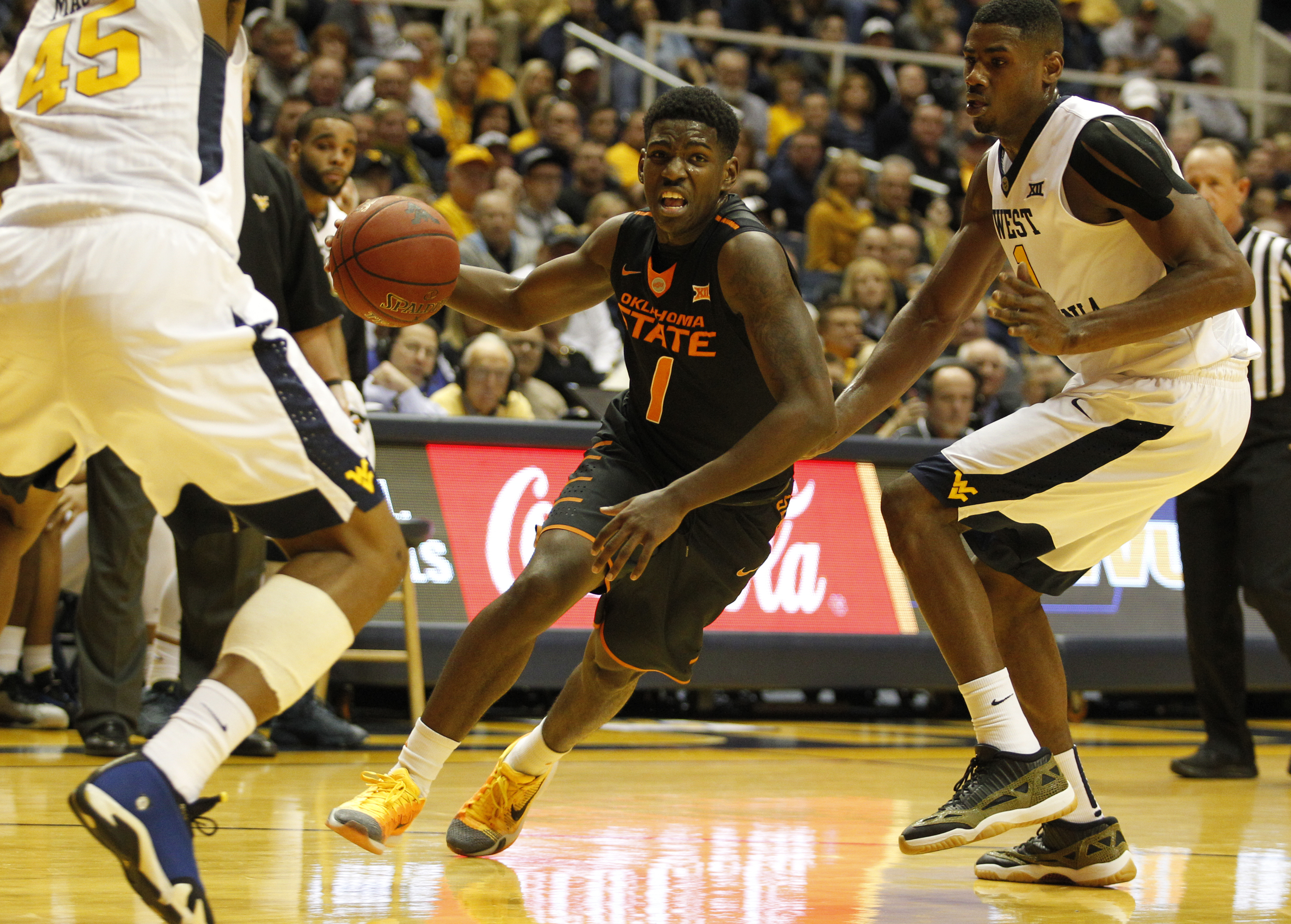 MORGANTOWN, WV - JANUARY 09: Jawun Evans #1 of the Oklahoma State Cowboys drives to the basket during the game against Jonathan Holton #1 of the West Virginia Mountaineers at the WVU Coliseum on January 9, 2016 in Morgantown, West Virginia. (Photo by Justin K. Aller/Getty Images)