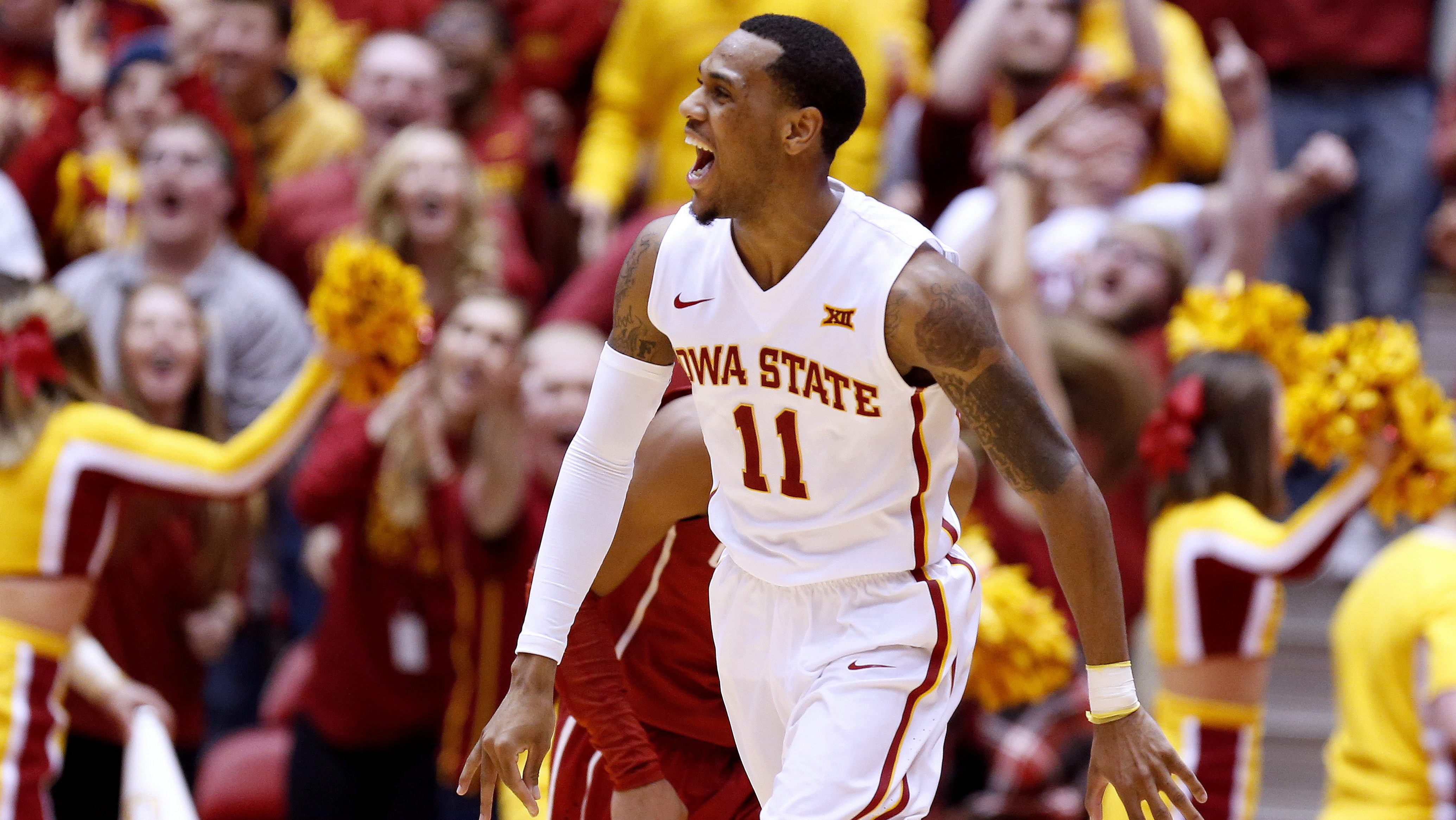 AMES, IA - JANUARY 18: Monte Morris #11 of the Iowa State Cyclones celebrates after scoring a three point basket in the second half of play against the Oklahoma Sooners at Hilton Coliseum on January 18, 2016 in Ames, Iowa. The Iowa State Cyclones won 82-77 over the Oklahoma Sooners. (Photo by David Purdy/Getty Images)