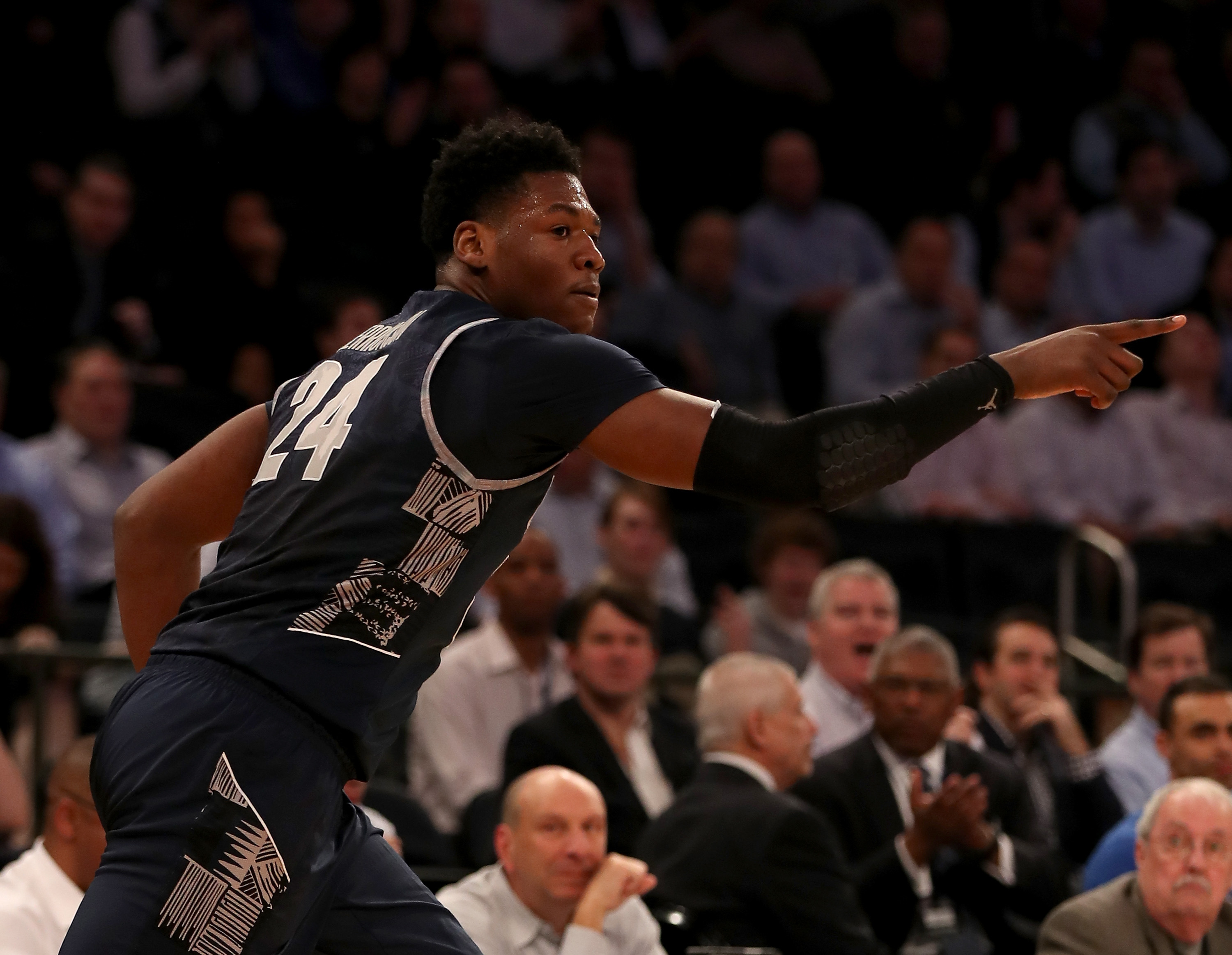 NEW YORK, NY - MARCH 10: Marcus Derrickson #24 of the Georgetown Hoyas celebrates his three point shot in the first half against the Villanova Wildcats during the quarterfinals of the Big East Basketball Tournament on March 10, 2016 at Madison Square Garden in New York City. (Photo by Elsa/Getty Images)
