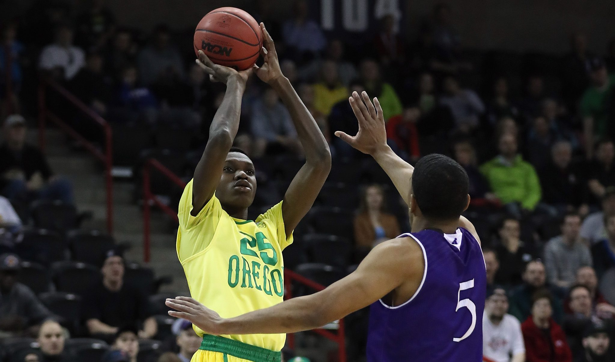 SPOKANE, WA - MARCH 18: Chris Boucher #25 of the Oregon Ducks shoots against Cullen Hamilton #5 of the Holy Cross Crusaders in the first half during the first round of the 2016 NCAA Men's Basketball Tournament at Spokane Veterans Memorial Arena on March 18, 2016 in Spokane, Washington. (Photo by Ezra Shaw/Getty Images)