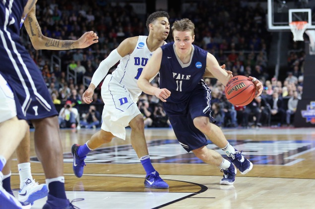 PROVIDENCE, RI - MARCH 19: Makai Mason #11 of the Yale Bulldogs dribbles the ball in the first half against the Duke Blue Devils during the second round of the 2016 NCAA Men's Basketball Tournament at Dunkin' Donuts Center on March 19, 2016 in Providence, Rhode Island. (Photo by Jim Rogash/Getty Images)
