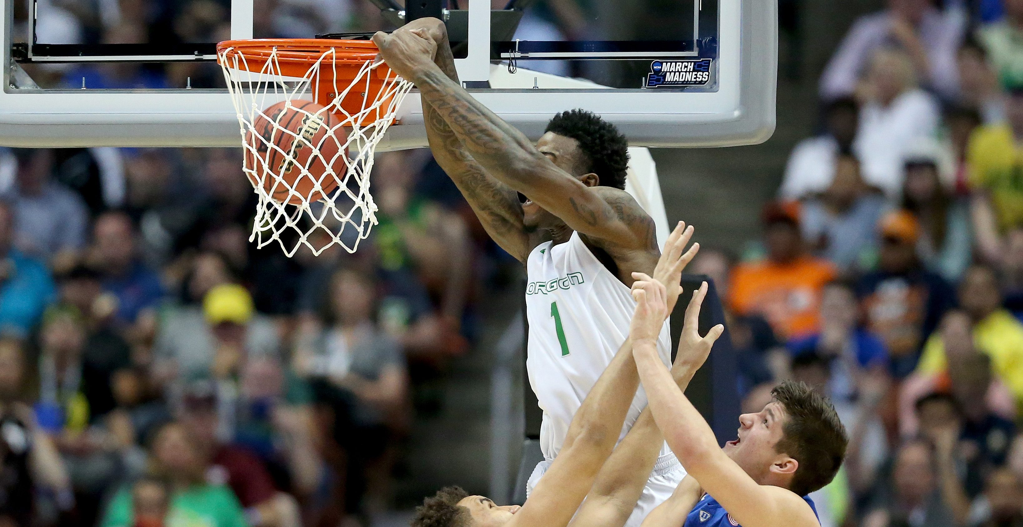 ANAHEIM, CA - MARCH 24: Jordan Bell #1 of the Oregon Ducks dunks the ball against Chase Jeter #2 and Grayson Allen #3 of the Duke Blue Devils in the first half in the 2016 NCAA Men's Basketball Tournament West Regional at the Honda Center on March 24, 2016 in Anaheim, California. (Photo by Sean M. Haffey/Getty Images)