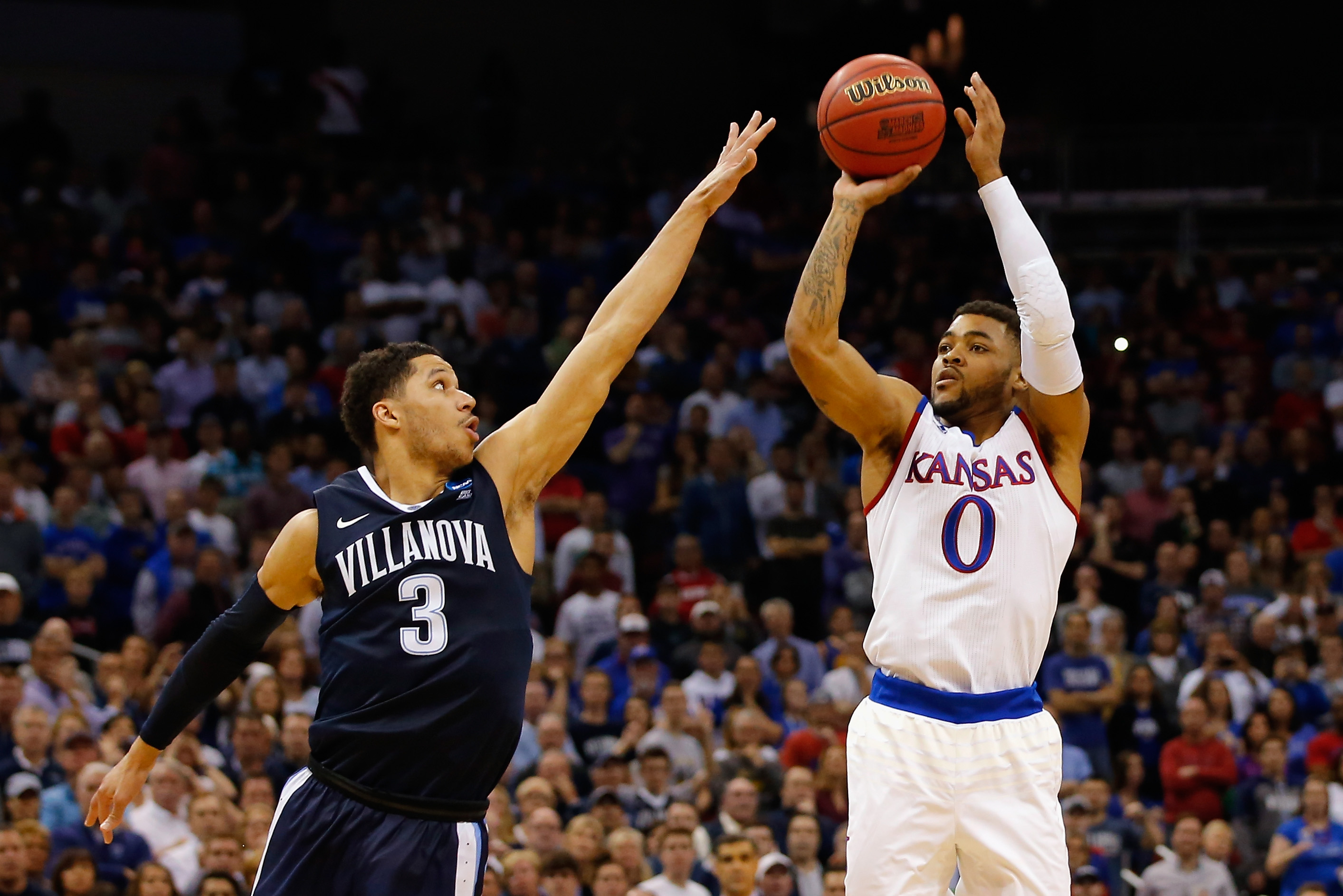 LOUISVILLE, KY - MARCH 26: Frank Mason III #0 of the Kansas Jayhawks shoots the ball against Josh Hart #3 of the Villanova Wildcats in the second half during the 2016 NCAA Men's Basketball Tournament South Regional at KFC YUM! Center on March 26, 2016 in Louisville, Kentucky. (Photo by Kevin C. Cox/Getty Images)