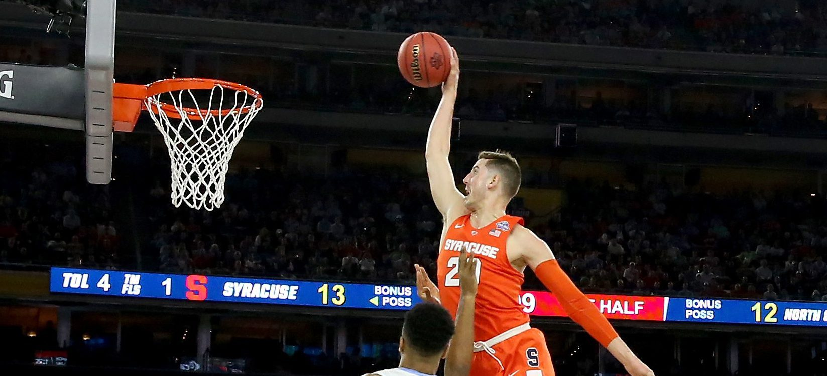 HOUSTON, TEXAS - APRIL 02:  Tyler Lydon #20 of the Syracuse Orange attempts to dunk the ball against Isaiah Hicks #4 of the North Carolina Tar Heels in the first half during the NCAA Men's Final Four Semifinal at NRG Stadium on April 2, 2016 in Houston, Texas.  (Photo by Ronald Martinez/Getty Images)