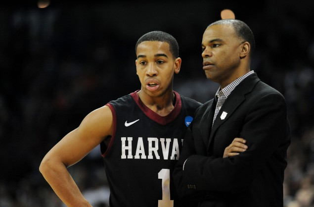 SPOKANE, WA - MARCH 22: Head coach Tommy Amaker talks to Siyani Chambers #1 of the Harvard Crimson in the first half against the Michigan State Spartans during the Third Round of the 2014 NCAA Basketball Tournament at Spokane Veterans Memorial Arena on March 22, 2014 in Spokane, Washington. (Photo by Steve Dykes/Getty Images)
