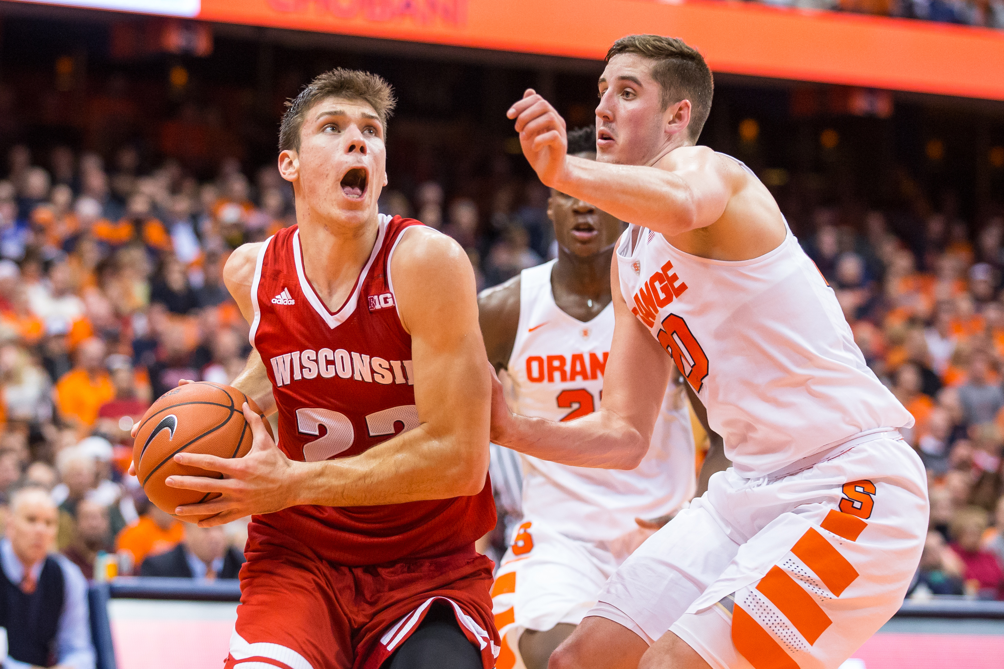 SYRACUSE, NY - DECEMBER 02: Ethan Happ #22 of the Wisconsin Badgers drives to the basket as Tyler Lydon #20 of the Syracuse Orange defends during the first half on December 2, 2015 at The Carrier Dome in Syracuse, New York. (Photo by Brett Carlsen/Getty Images)