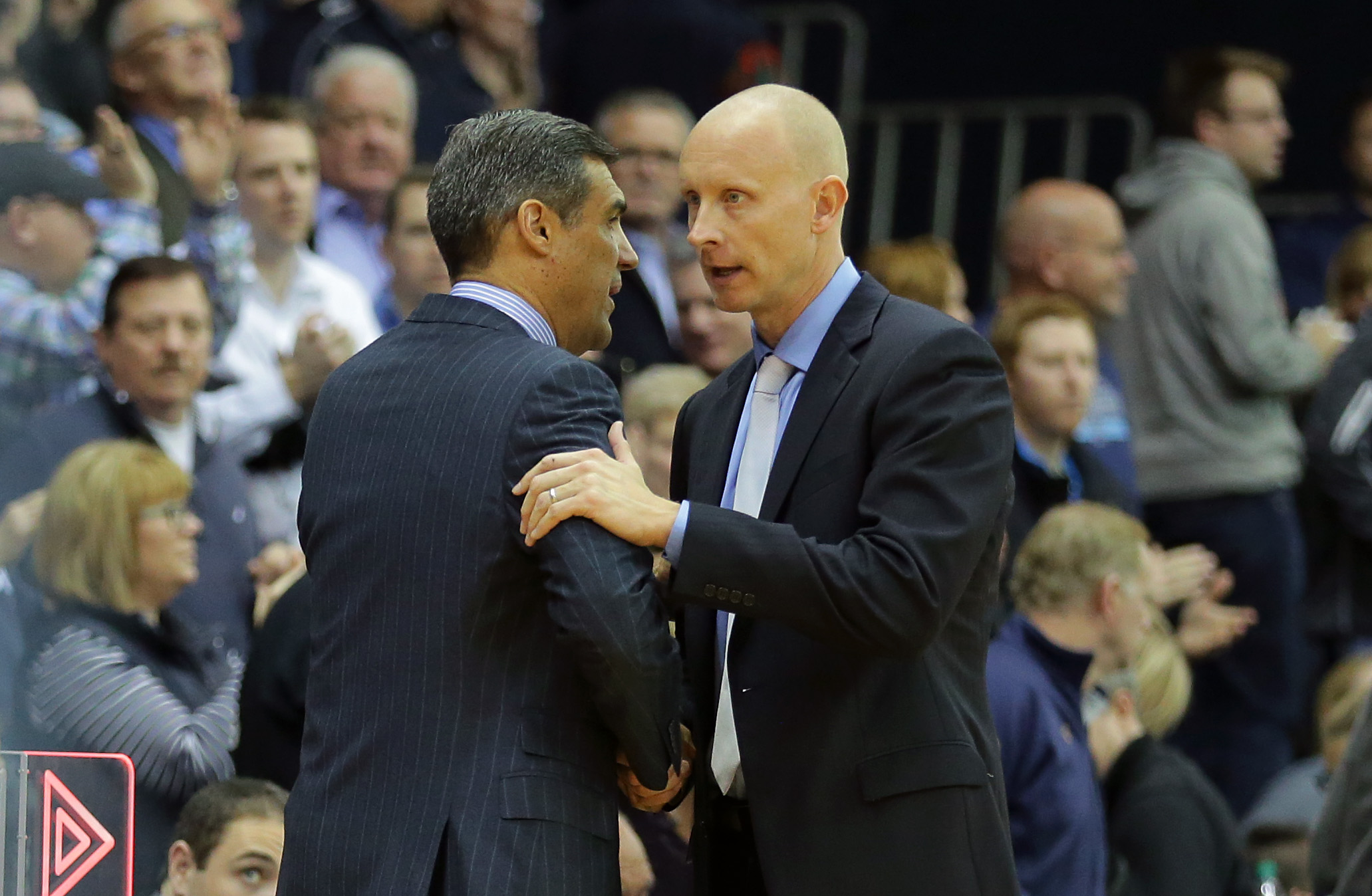 VILLANOVA, PA - DECEMBER 31: Head coach Jay Wright of the Villanova Wildcats shakes hands with head coach Chris Mack of the Xavier Musketeers after a game at the Pavilion on the campus of Villanova University on December 31, 2015 in Philadelphia, Pennsylvania.(Photo by Hunter Martin/Getty Images)