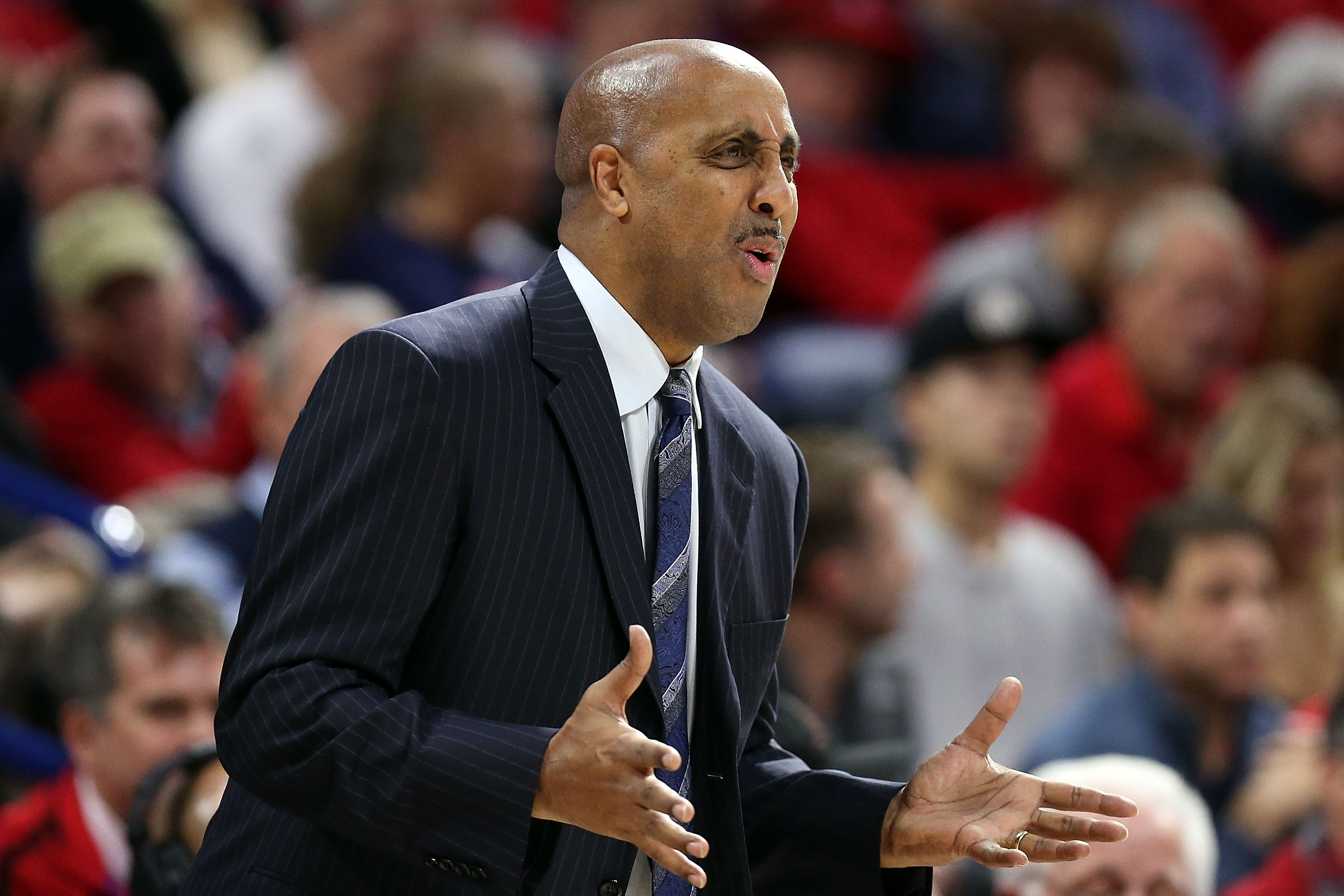 TUCSON, AZ - JANUARY 14: Head coach Lorenzo Romar of the Washington Huskies gestures during the first half of the college basketball game at McKale Center on January 14, 2016 in Tucson, Arizona. The Arizona Wildcats beat the Washington Huskies 99-67. (Photo by Chris Coduto/Getty Images)