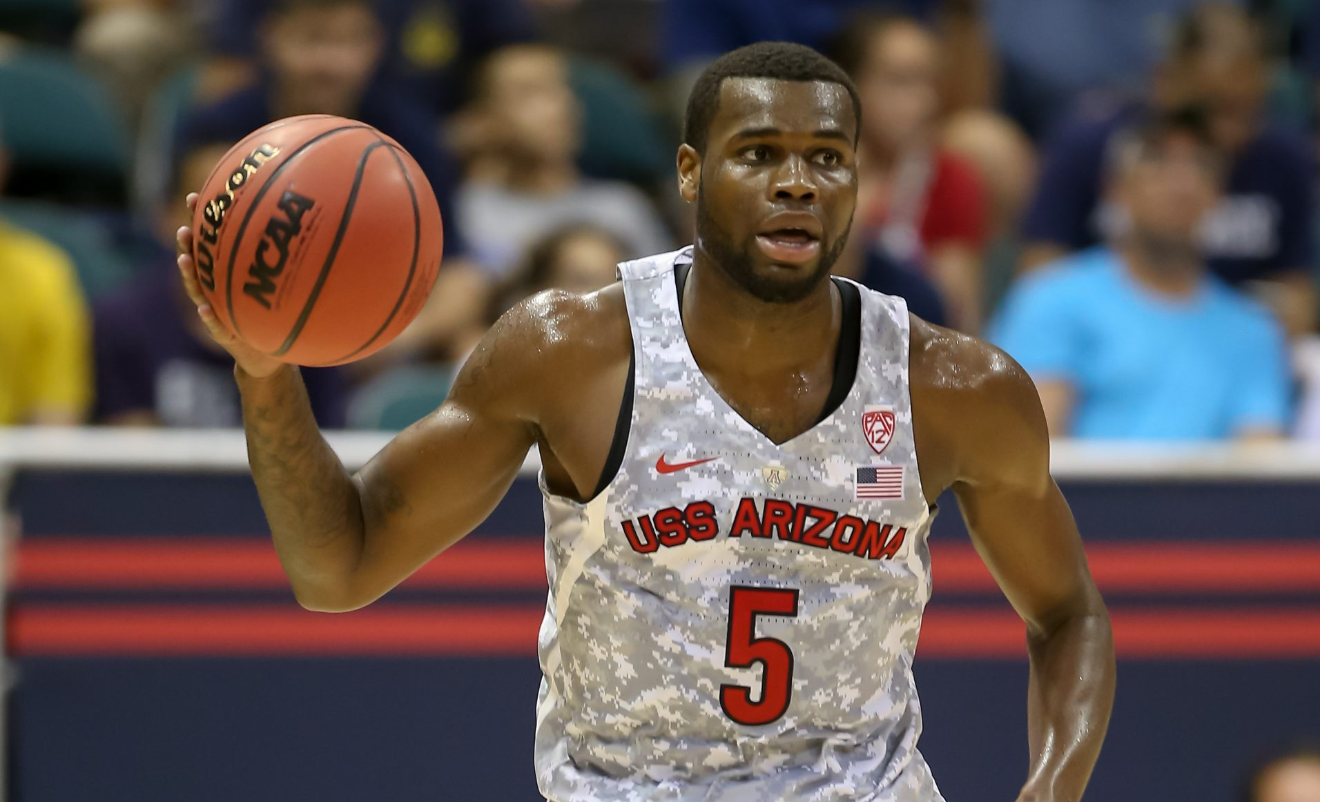 HONOLULU, HI - NOVEMBER 11: Kadeem Allen #5 of the Arizona Wildcats dribbles the ball up court during the first half of the Armed Forces Classic at the Stan Sheriff Center on November 11, 2016 in Honolulu, Hawaii. (Photo by Darryl Oumi/Getty Images)