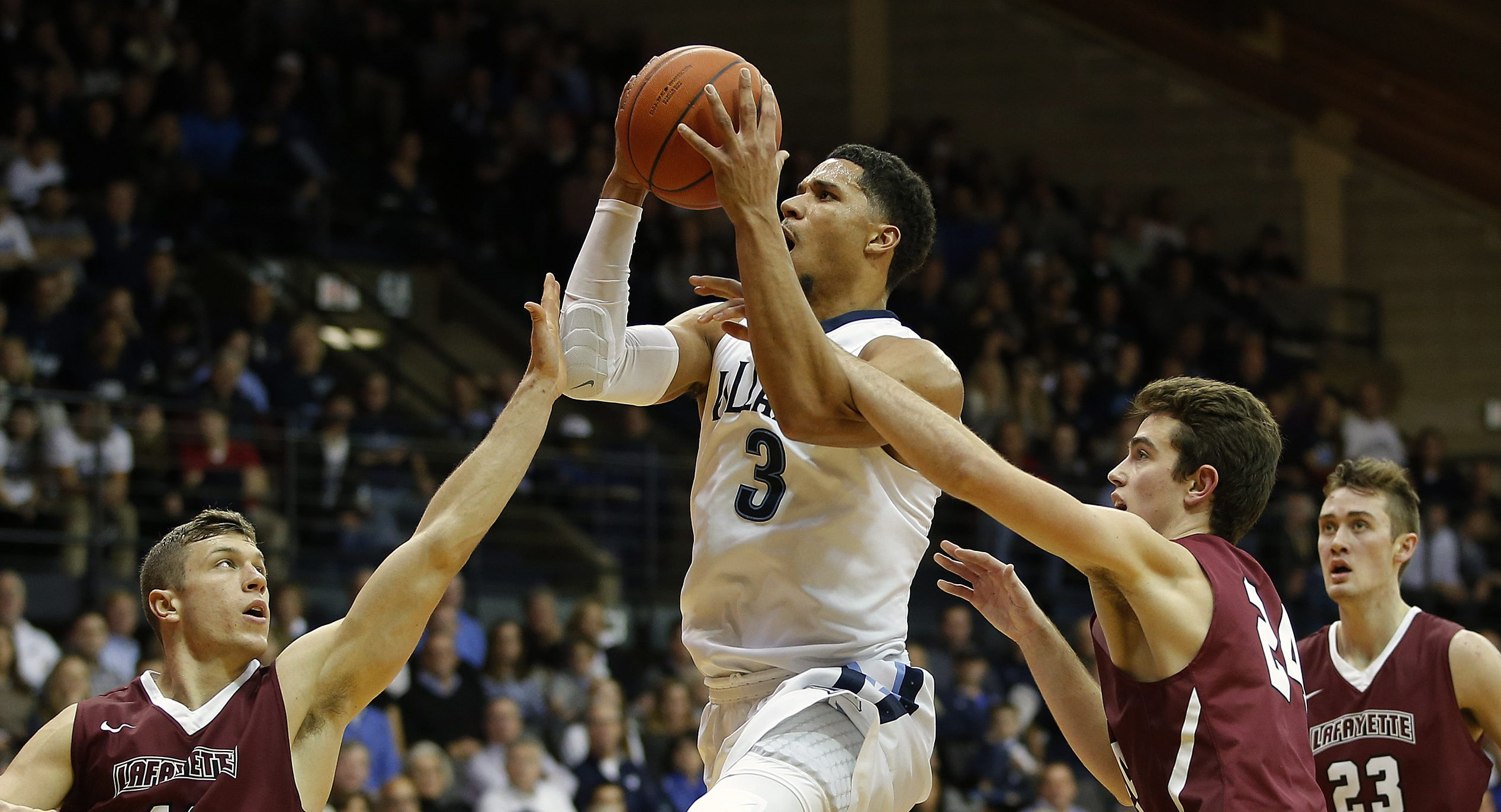 VILLANOVA, PA - NOVEMBER 11: Josh Hart #3 of Villanova attempts a shot as Nick Lindner #11 and Kyle Stout #24 of Lafayette defend during the second half of a game at The Pavilion on November 11, 2016 in Villanova, Pennsylvania. Villanova defeated Lafayette 88-48. (Photo by Rich Schultz/Getty Images)