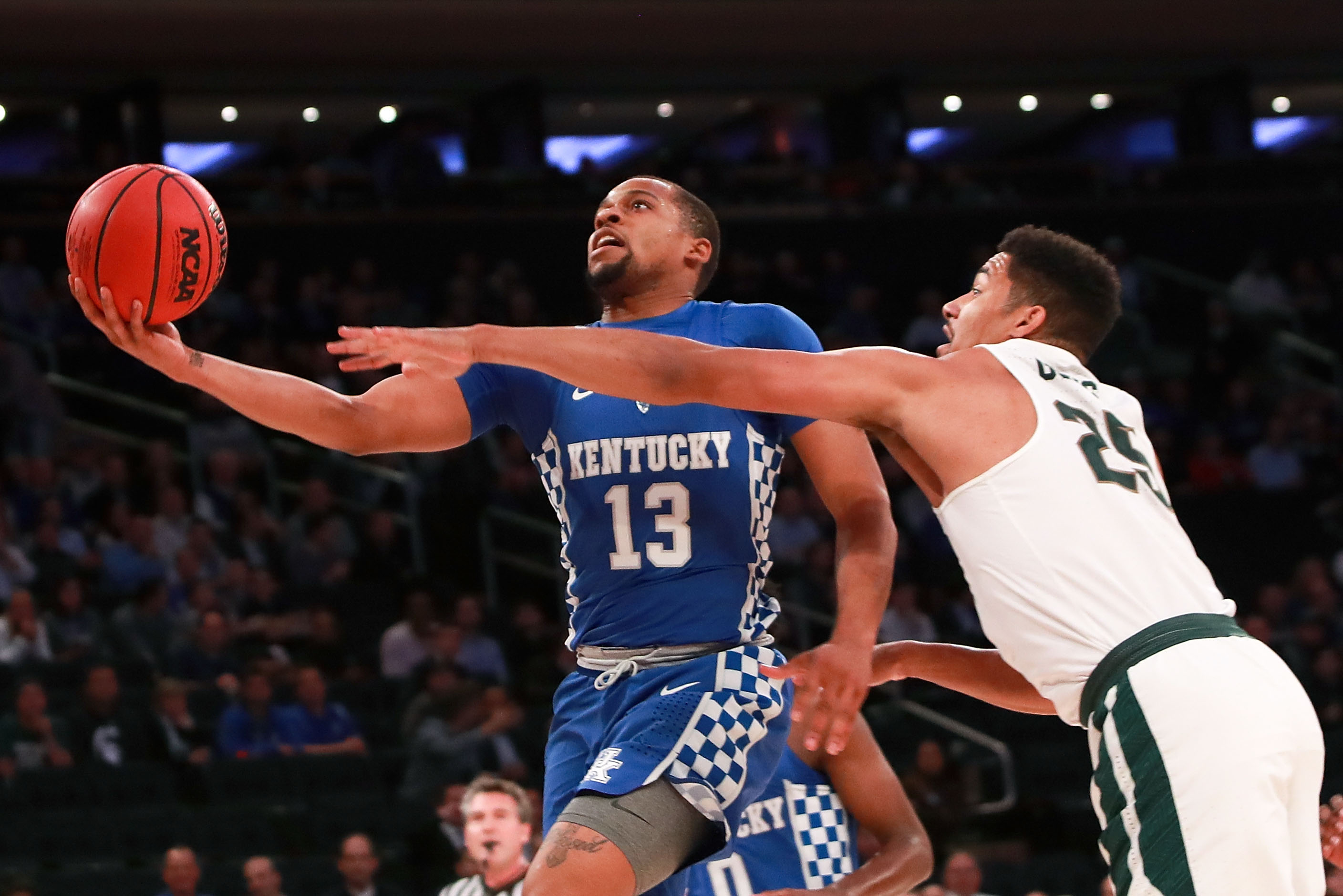 NEW YORK, NY - NOVEMBER 15: Isaiah Briscoe #13 of the Kentucky Wildcats puts up a shot against Kenny Goins #25 of the Michigan State Spartans in the first half during the State Farm Champions Classic at Madison Square Garden on November 15, 2016 in New York City. (Photo by Michael Reaves/Getty Images)