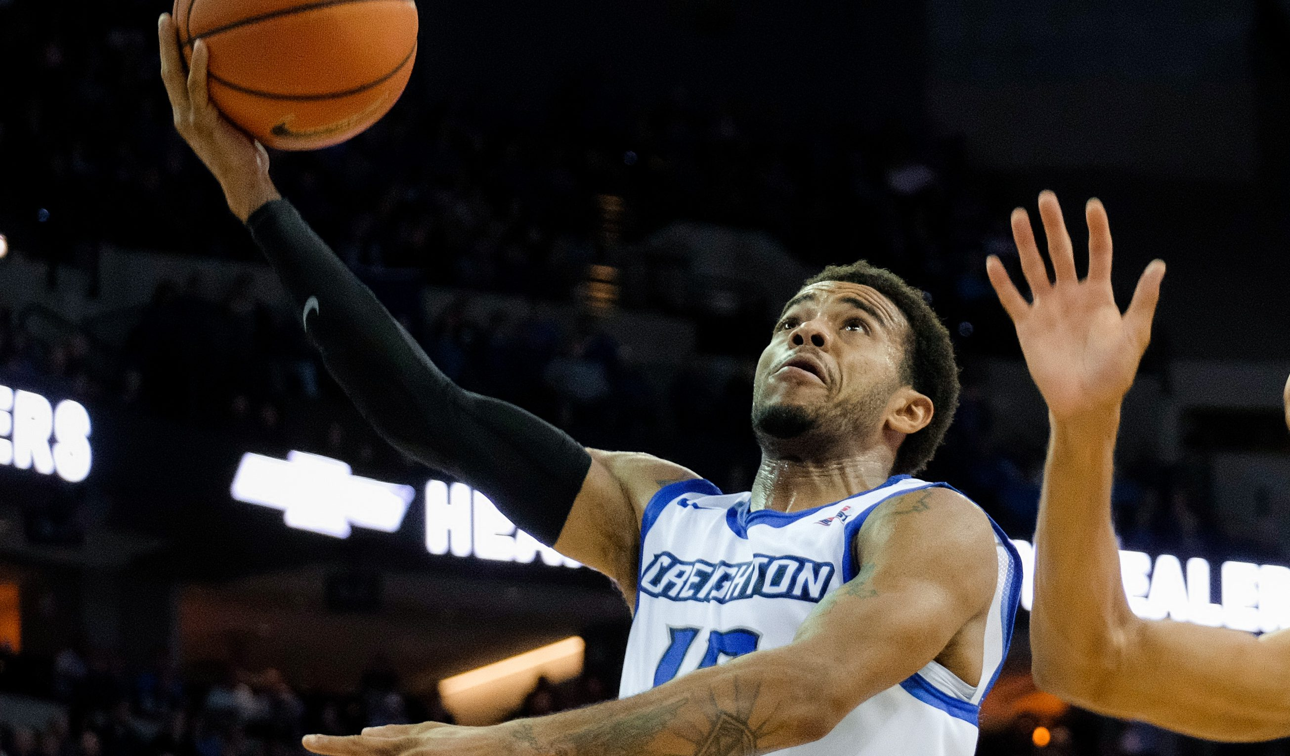 OMAHA, NE - NOVEMBER 15: Maurice Watson Jr. #10 of the Creighton Bluejays drives to the hoop past Jordan Hill #11 of the Wisconsin Badgers during their game at the CenturyLink Center on November 15, 2016 in Omaha, Nebraska. (Photo by Eric Francis/Getty Images)