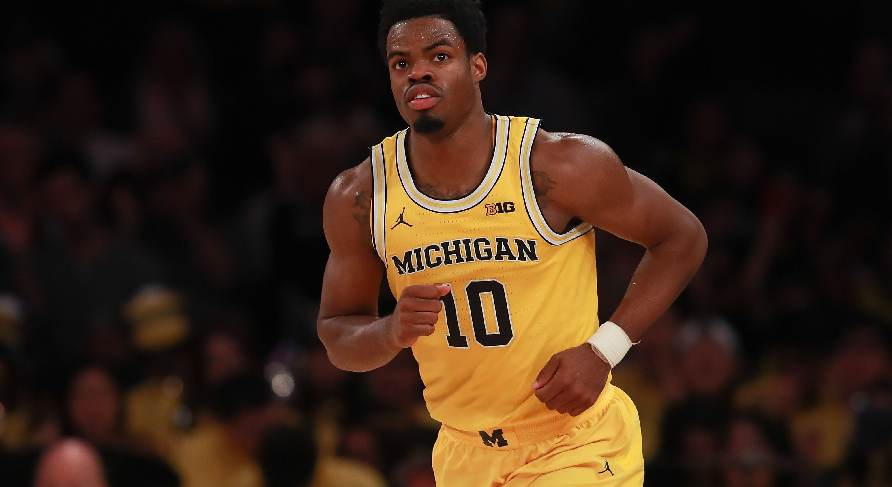 NEW YORK, NY - NOVEMBER 18: Derrick Walton Jr. #10 of the Michigan Wolverines reacts after hitting a three pointer against the Southern Methodist Mustangs in the second half of the 2K Classic Championship at Madison Square Garden on November 18, 2016 in New York City. (Photo by Michael Reaves/Getty Images)