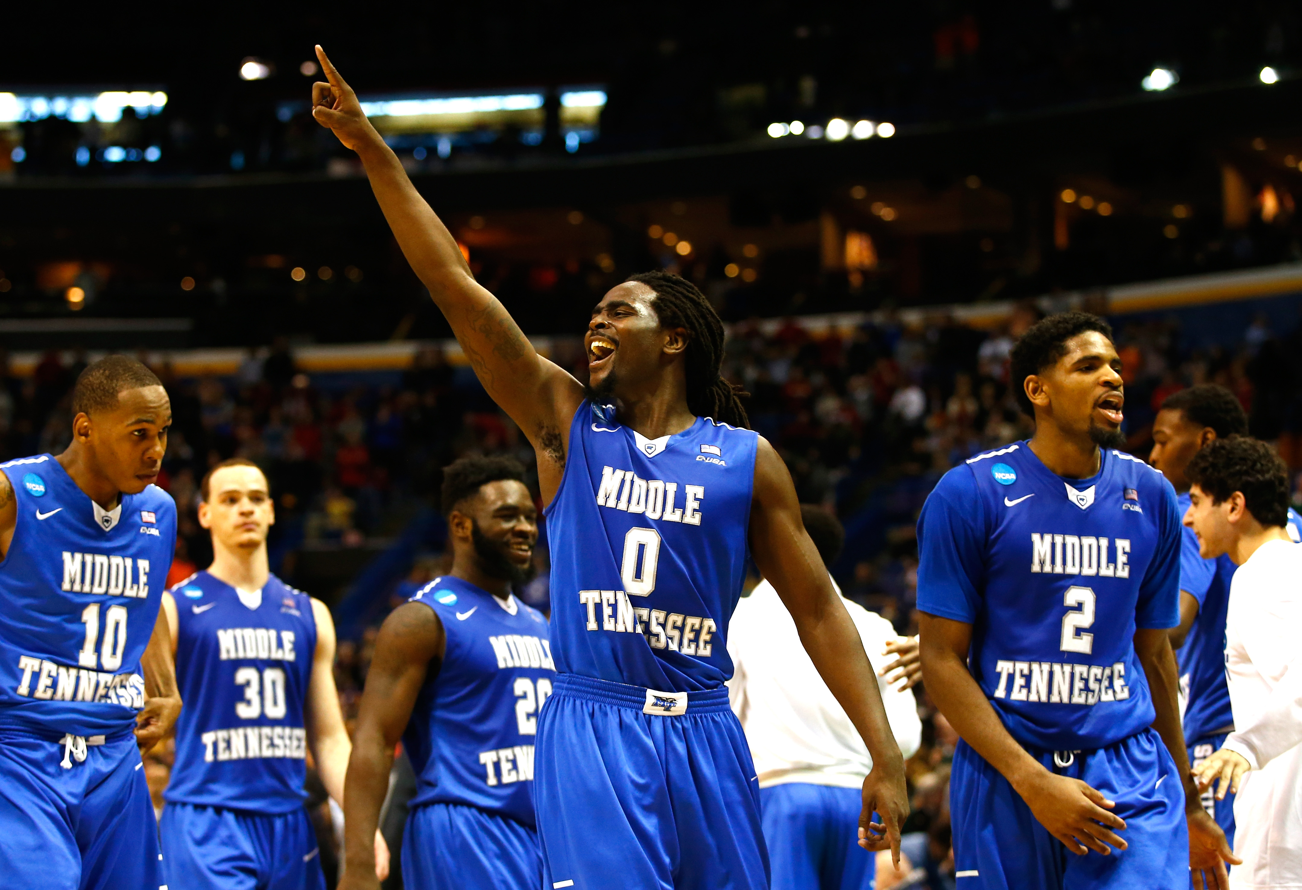 ST LOUIS, MO - MARCH 18: Darnell Harris #0 of the Middle Tennessee Blue Raiders celebrates late in the game against the Michigan State Spartans during the first round of the 2016 NCAA Men's Basketball Tournament at Scottrade Center on March 18, 2016 in St Louis, Missouri. (Photo by Jamie Squire/Getty Images)