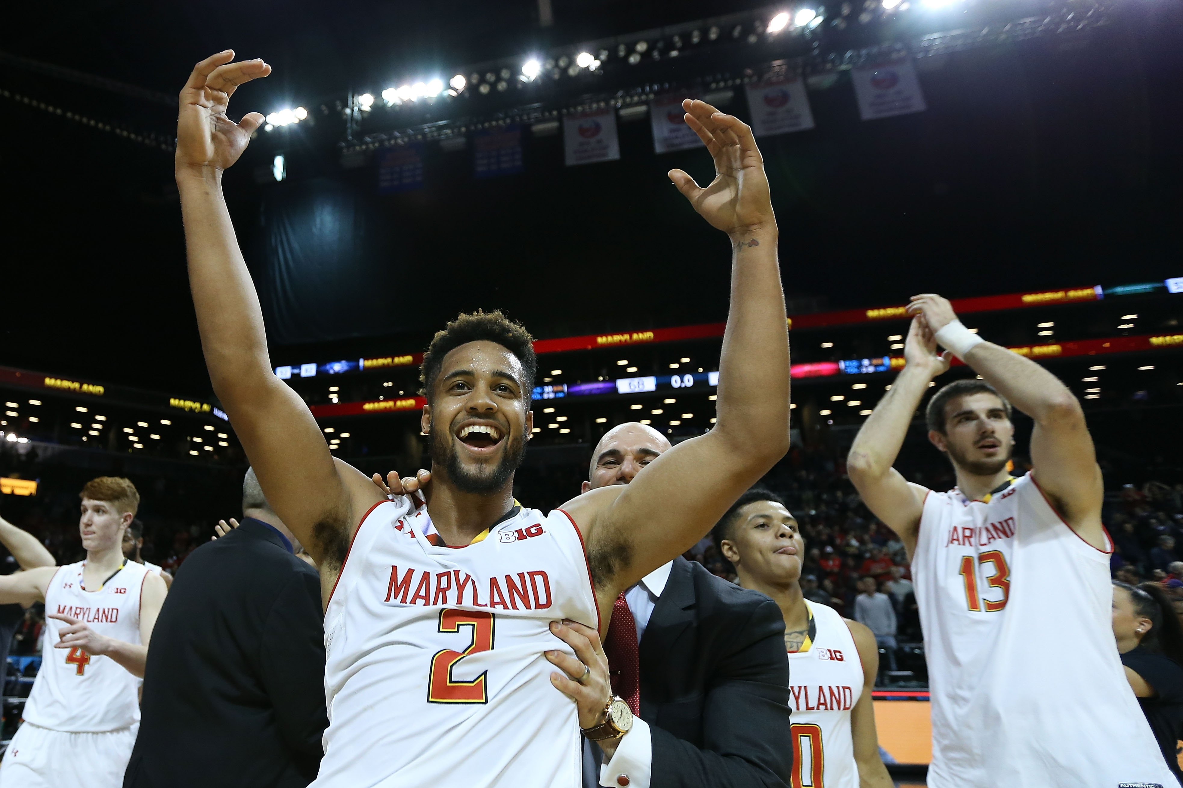 NEW YORK, NY - NOVEMBER 26: Melo Trimble #2 of the Maryland Terrapins celebrates after hitting the game winning shot as they defeated the Kansas State Wildcats 69-68 during the championship game of the Barclays Center Classic at Barclays Center on November 26, 2016 in the Brooklyn borough of New York City. (Photo by Michael Reaves/Getty Images)