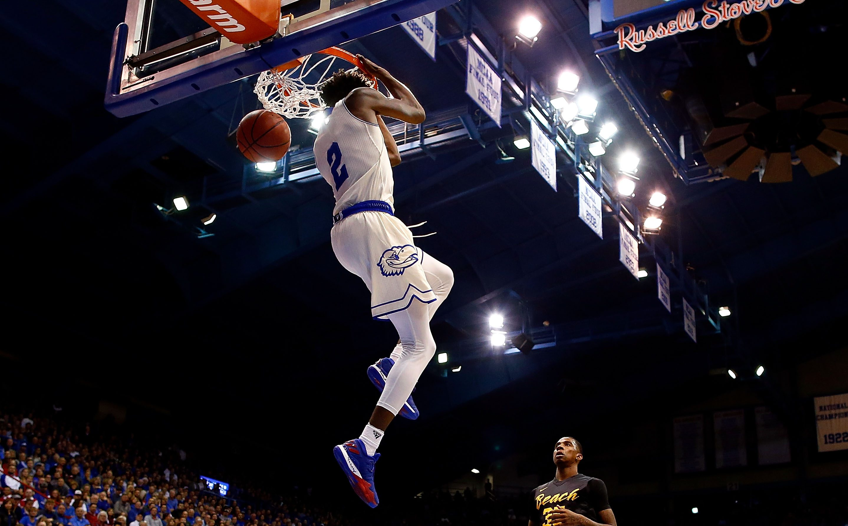 LAWRENCE, KS - NOVEMBER 29: Lagerald Vick #2 of the Kansas Jayhawks dunks on a fast break as Javonntie Jackson #35 of the Long Beach State 49ers looks on during the game at Allen Fieldhouse on November 29, 2016 in Lawrence, Kansas. (Photo by Jamie Squire/Getty Images)