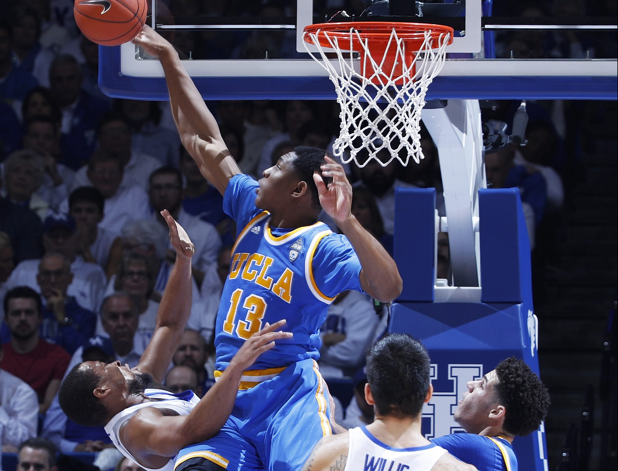 LEXINGTON, KY - DECEMBER 03: Ike Anigbogu #13 of the UCLA Bruins blocks a shot by Isaiah Briscoe #13 of the Kentucky Wildcats in the first half of the game at Rupp Arena on December 3, 2016 in Lexington, Kentucky. UCLA defeated Kentucky 97-92. (Photo by Joe Robbins/Getty Images)
