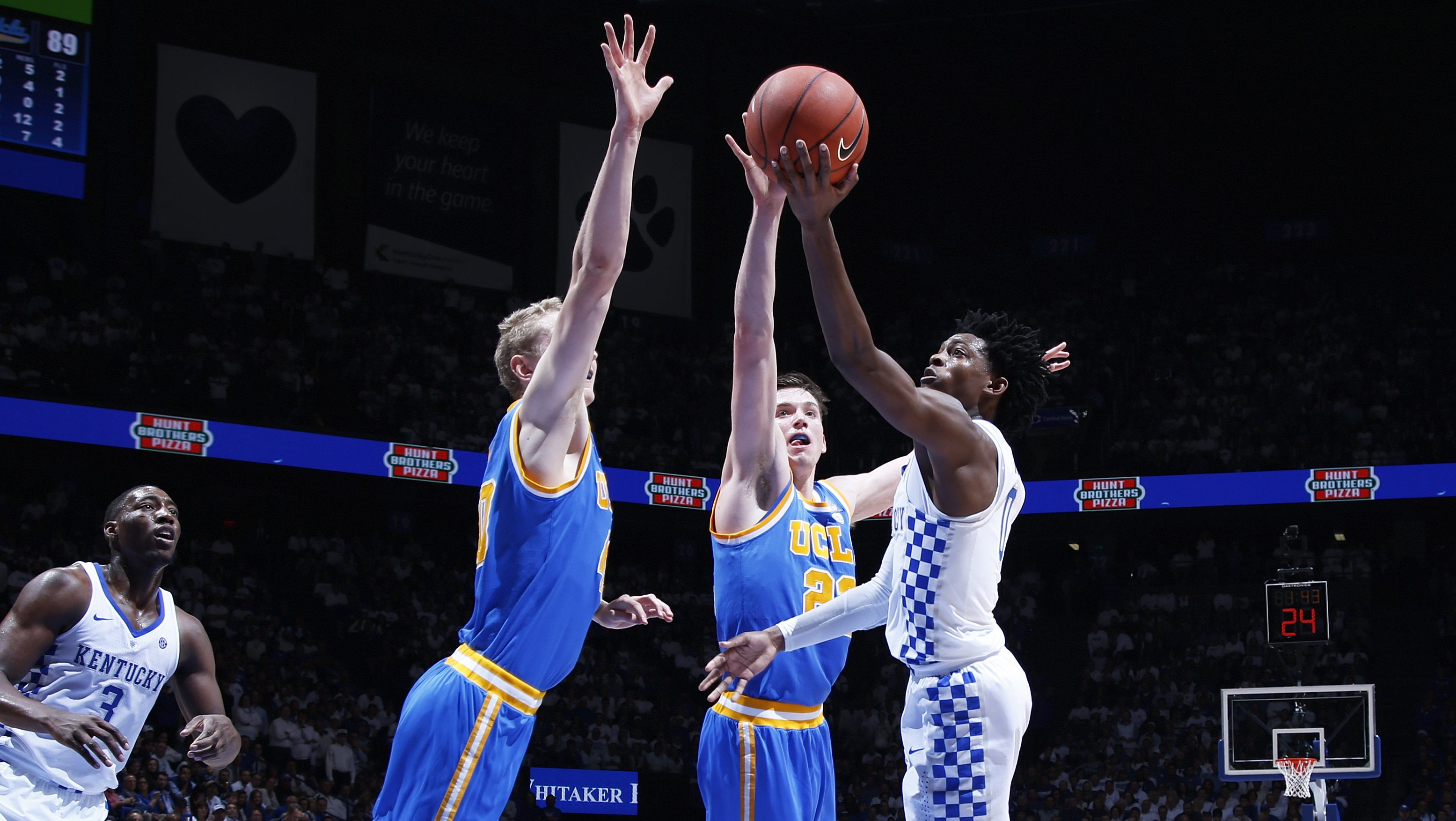 LEXINGTON, KY - DECEMBER 03: Thomas Welsh #40 and TJ Leaf #22 of the UCLA Bruins defend against De'Aaron Fox #0 of the Kentucky Wildcats in the second half of the game at Rupp Arena on December 3, 2016 in Lexington, Kentucky. UCLA defeated Kentucky 97-92. (Photo by Joe Robbins/Getty Images)