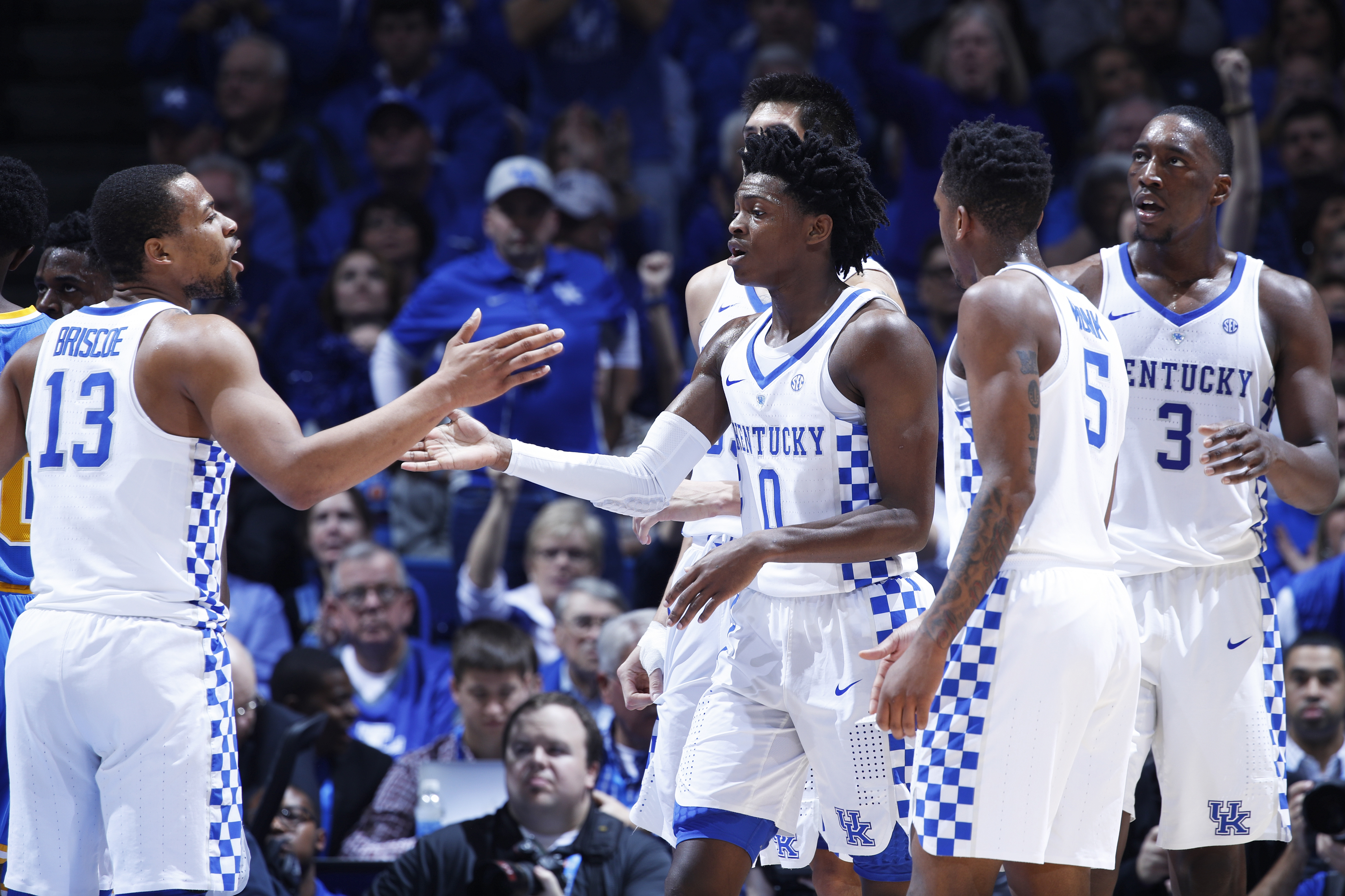 LEXINGTON, KY - DECEMBER 03: De'Aaron Fox #0 and Isaiah Briscoe #13 of the Kentucky Wildcats celebrate in the first half of the game against the UCLA Bruins at Rupp Arena on December 3, 2016 in Lexington, Kentucky. UCLA defeated Kentucky 97-92. (Photo by Joe Robbins/Getty Images)
