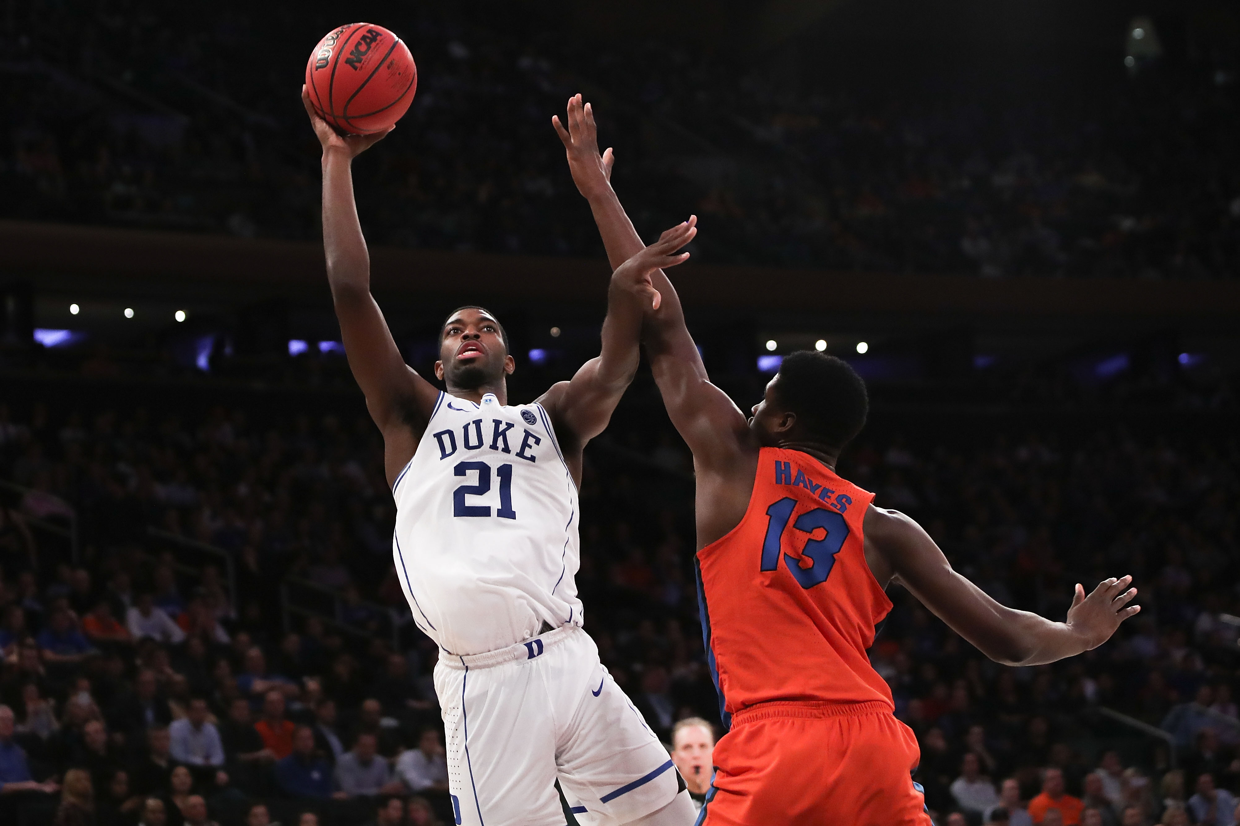 NEW YORK, NY - DECEMBER 06:  Amile Jefferson #21 of the Duke Blue Devils puts up a shot against the Florida Gators in the second half during the Jimmy V Classic at Madison Square Garden on December 6, 2016 in New York City.  (Photo by Michael Reaves/Getty Images)