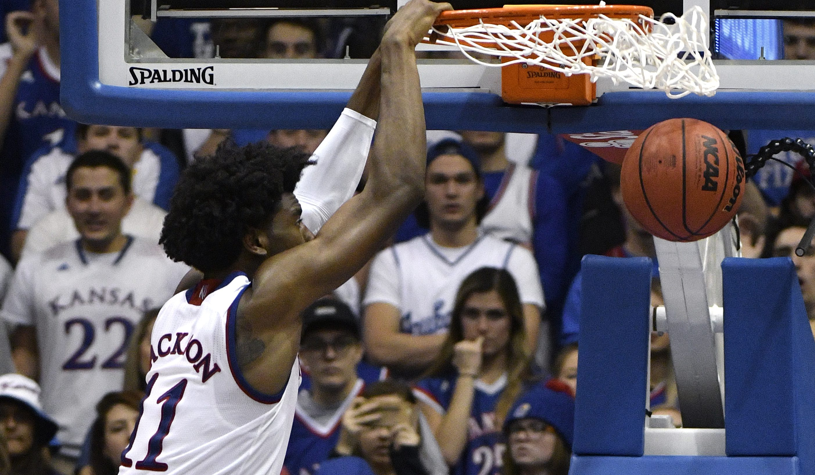 LAWRENCE, KS - DECEMBER 10: Josh Jackson #11 of the Kansas Jayhawks dunks he ball against the Nebraska Cornhuskers in the second half at Allen Field House on December 10, 2016 in Lawrence, Kansas. (Photo by Ed Zurga/Getty Images)