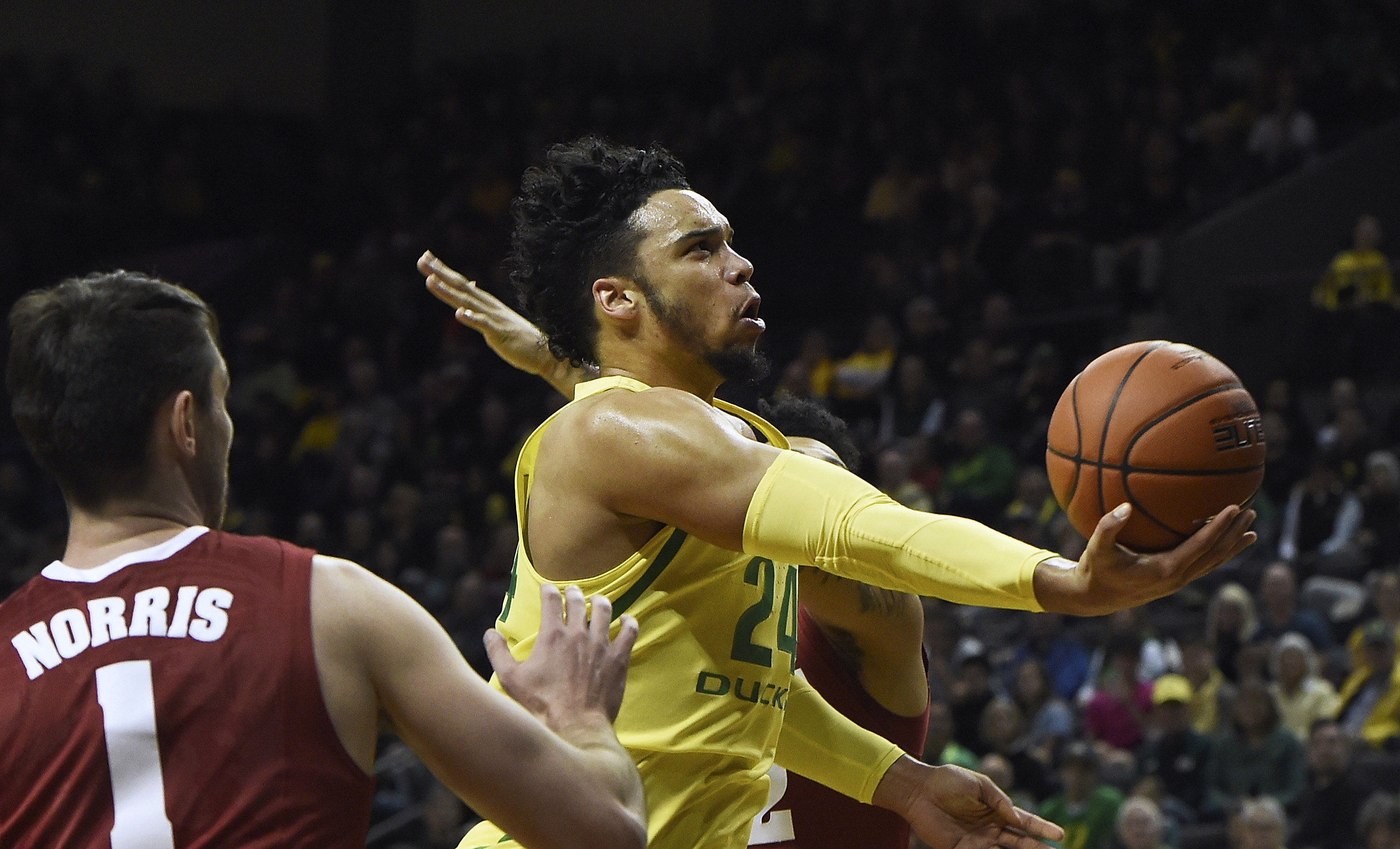 EUGENE, OR - DECEMBER 11: Dillon Brooks #24 of the Oregon Ducks drives to the basket on Riley Norris #1 of the Alabama Crimson Tide during the first half of the game at Matthew Knight Arena on December 11, 2016 in Eugene, Oregon. (Photo by Steve Dykes/Getty Images)