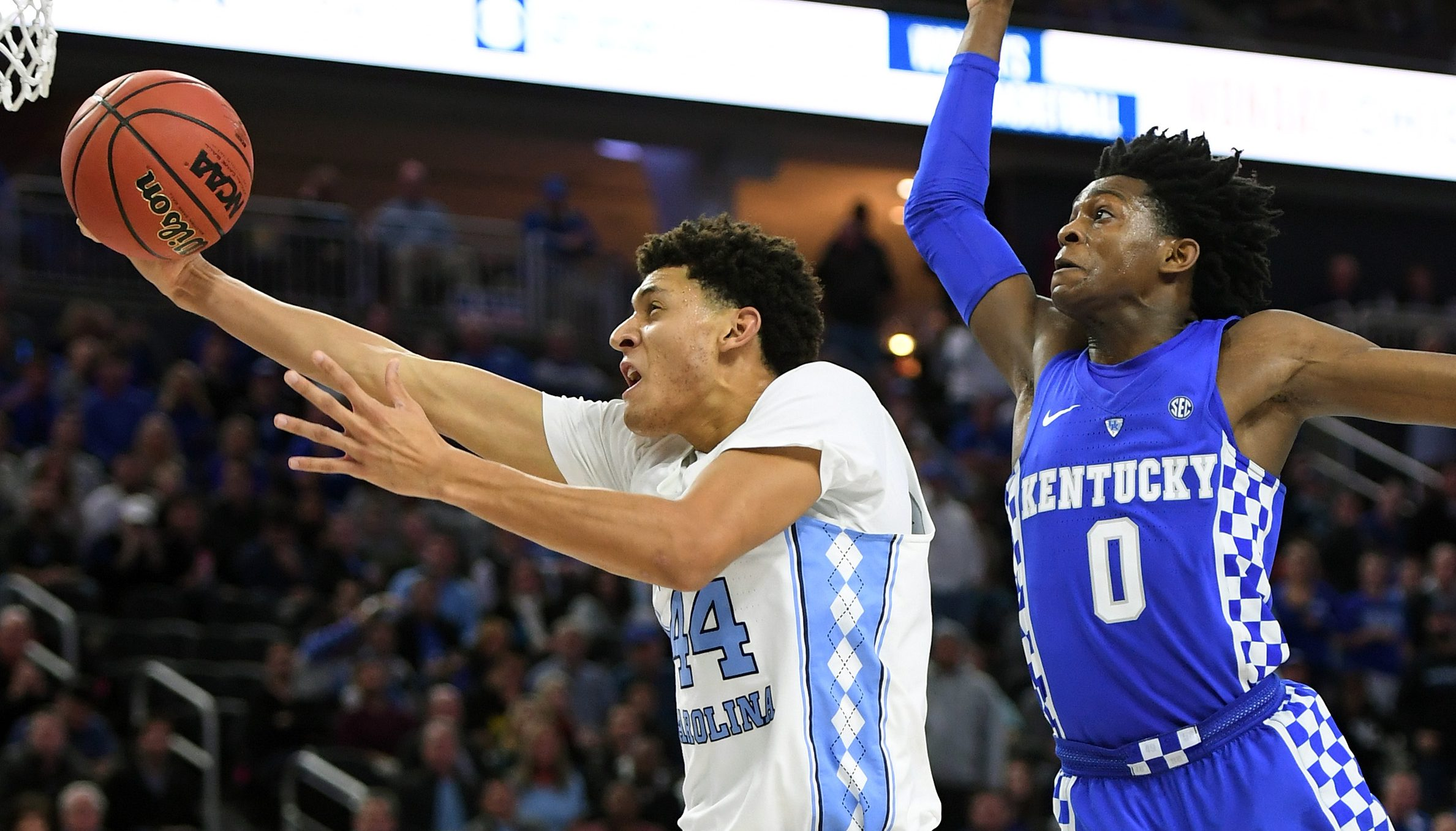 LAS VEGAS, NV - DECEMBER 17: Justin Jackson #44 of the North Carolina Tar Heels drives to the basket against De'Aaron Fox #0 of the Kentucky Wildcats during the CBS Sports Classic at T-Mobile Arena on December 17, 2016 in Las Vegas, Nevada. Kentucky won 103-100. (Photo by Ethan Miller/Getty Images)