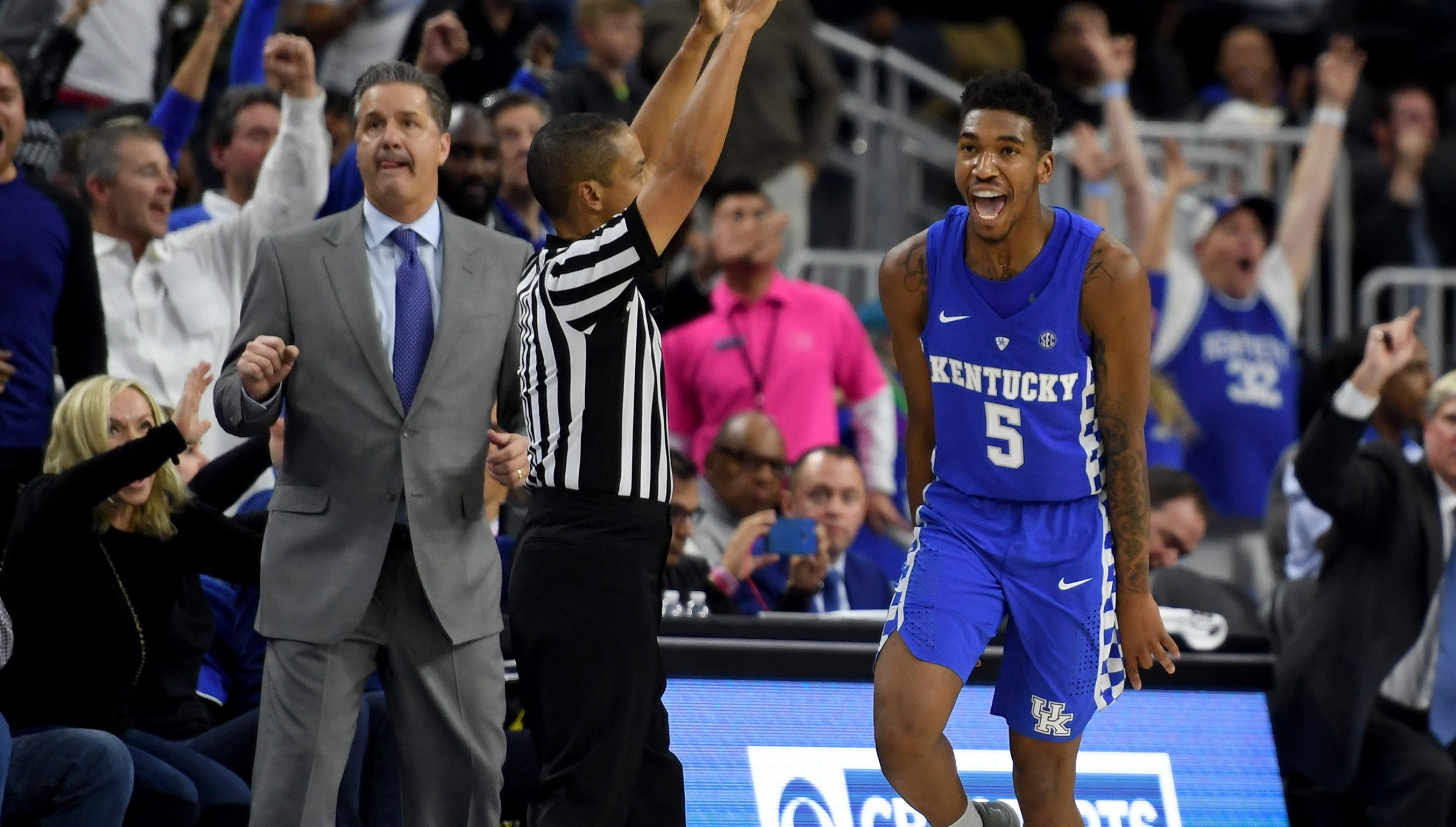 LAS VEGAS, NV - DECEMBER 17:  Head coach John Calipari of the Kentucky Wildcats looks on as Malik Monk #5 celebrates after hitting a go-ahead 3-pointer late in the team's 103-100 win over the North Carolina Tar Heels during the CBS Sports Classic at T-Mobile Arena on December 17, 2016 in Las Vegas, Nevada.  (Photo by Ethan Miller/Getty Images)
