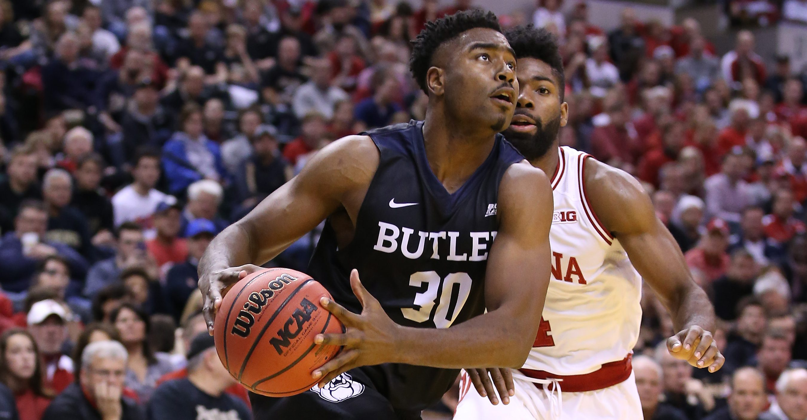 INDIANAPOLIS, IN - DECEMBER 17: Kelan Martin #30 of the Butler Bulldogs dribbles the ball during the 83-78 win over the Indiana Hoosiers during the Crossroads Classic at Bankers Life Fieldhouse on December 17, 2016 in Indianapolis, Indiana. (Photo by Andy Lyons/Getty Images)