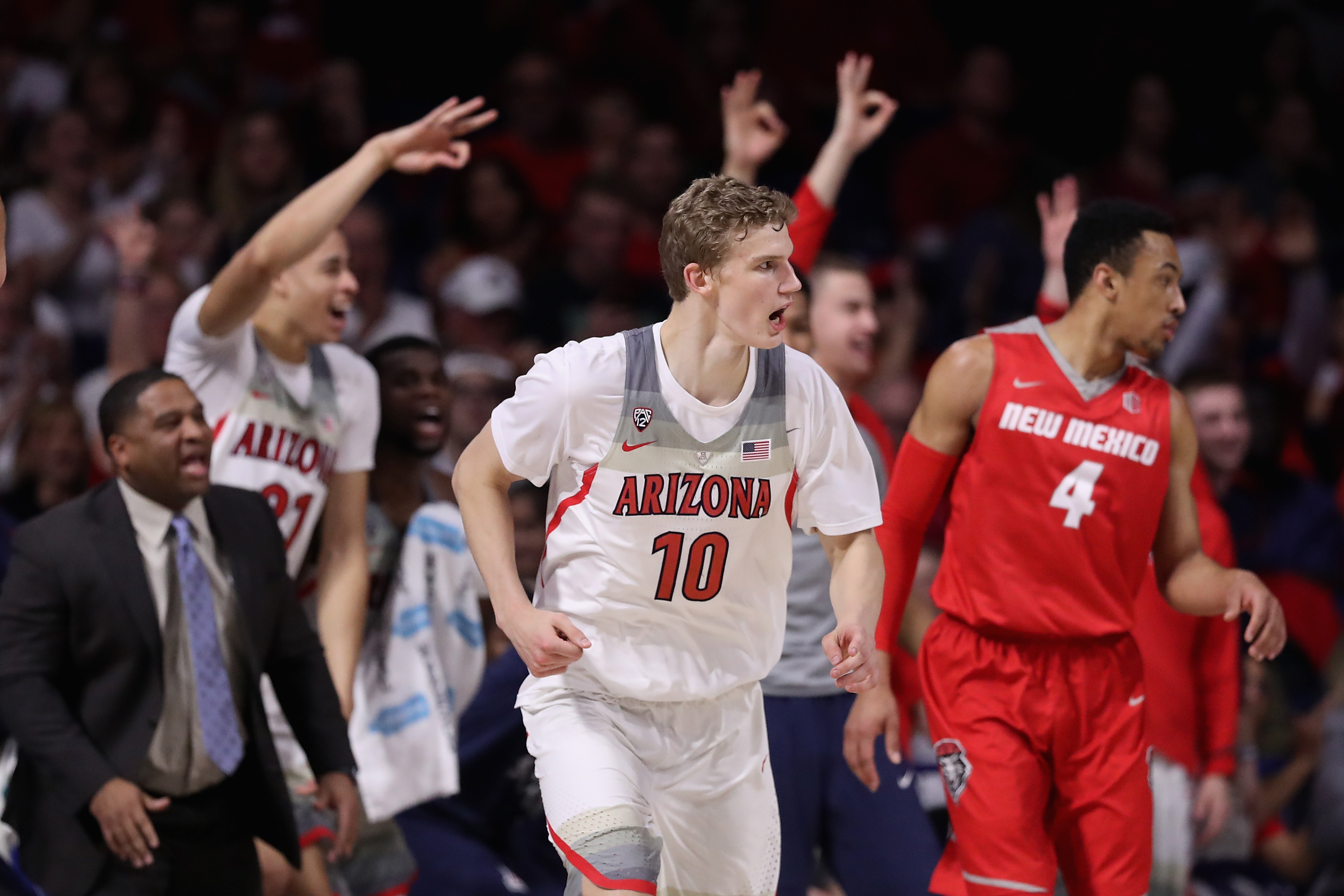 TUCSON, AZ - DECEMBER 20: Lauri Markkanen #10 of the Arizona Wildcats reacts after hitting a three point shot against the New Mexico Lobos during the second half of the college basketball game at McKale Center on December 20, 2016 in Tucson, Arizona. (Photo by Christian Petersen/Getty Images)